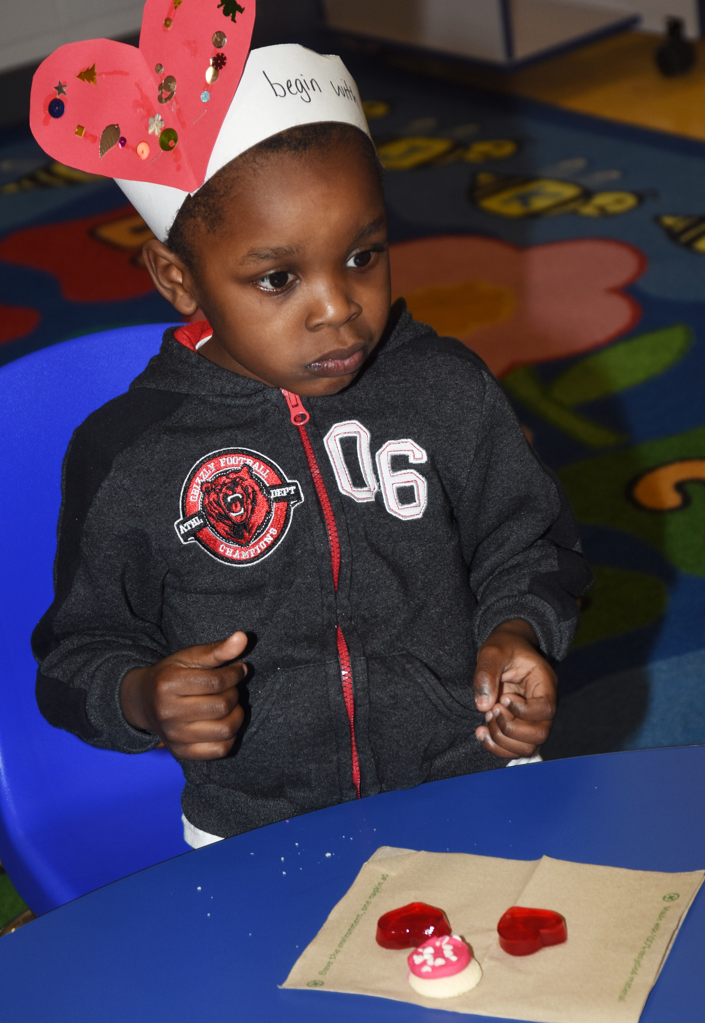 CES preschool student Xavien Smith enjoys Valentine snacks.