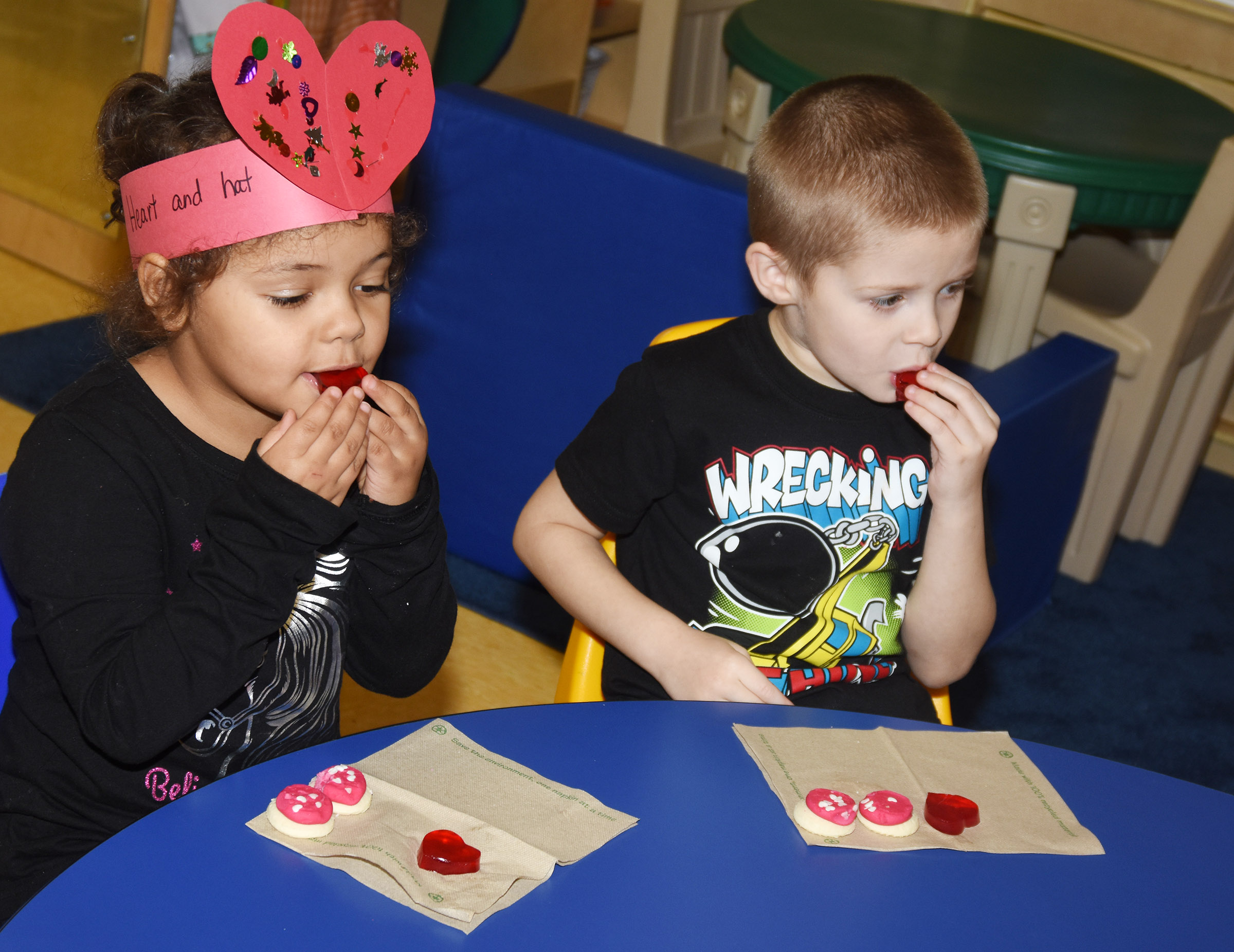 CES preschool students Amarya Penn-Thompson, at left, and Brian Daniels enjoy Jell-O in the shape of hearts.