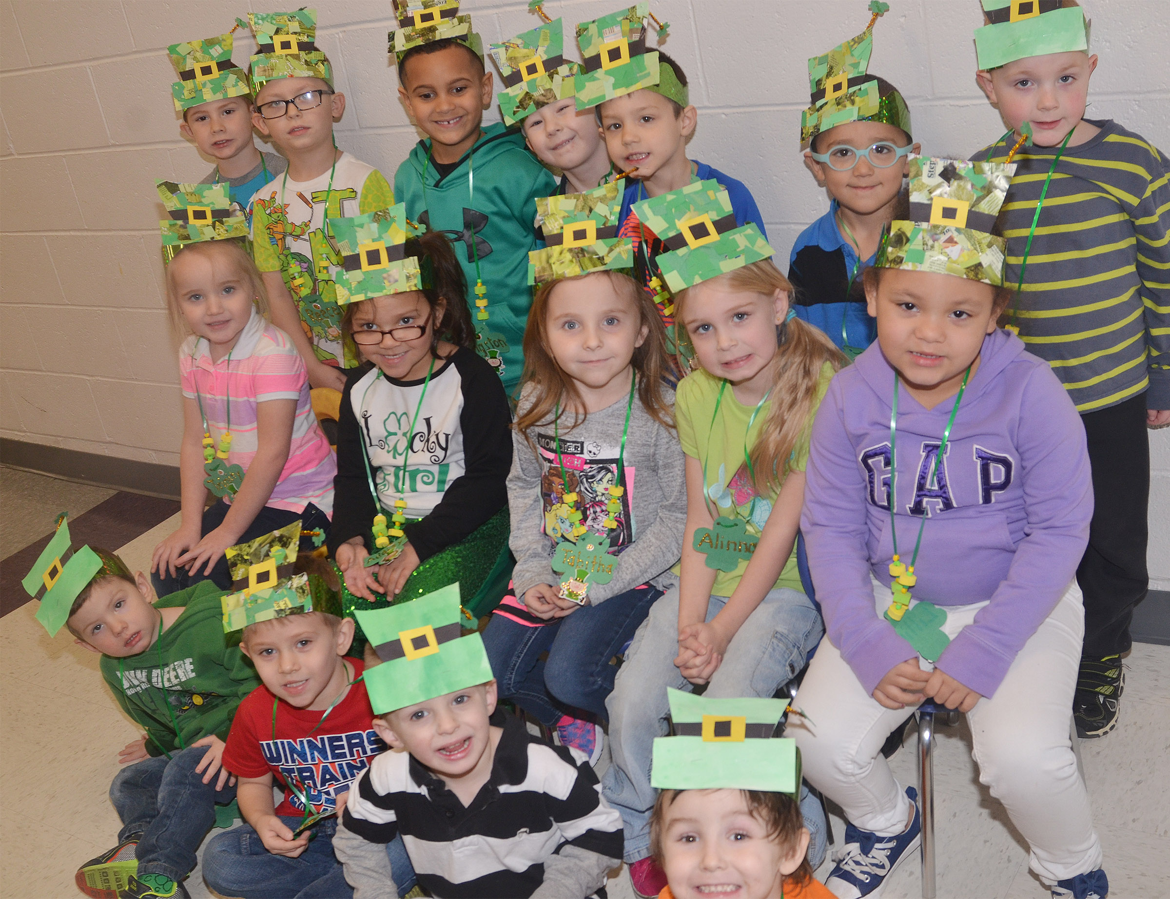 CES preschool students in Sherry Cowherd's class wear their St. Patrick's Day hats and necklaces. From left, front, are Chase Arnett, Elijah Russell, Nevon Stum and Noelan McMahan. Second row, Trinity Dye, Addisyn Taylor, Tabitha Leggett, Alinna Bray and Lillian Merriweather. Back, Kennon Dotson, Reece Williams, Kingston Cowherd, Cameron Dean, Levi Ritchie, Chanler Mann and Anthony McClure.