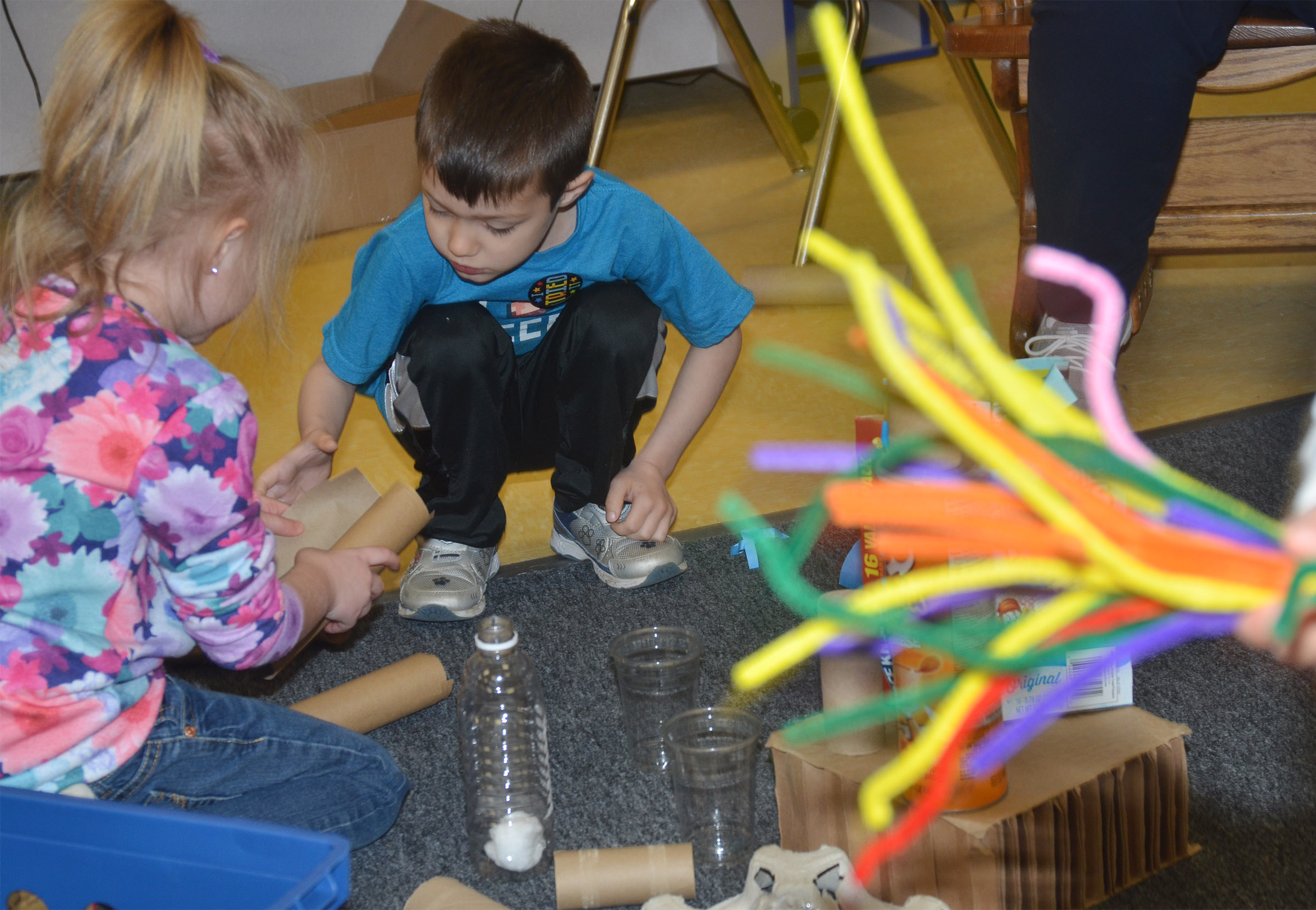 CES preschool students Trinity Dye, at left, and Levi Ritchie build together.