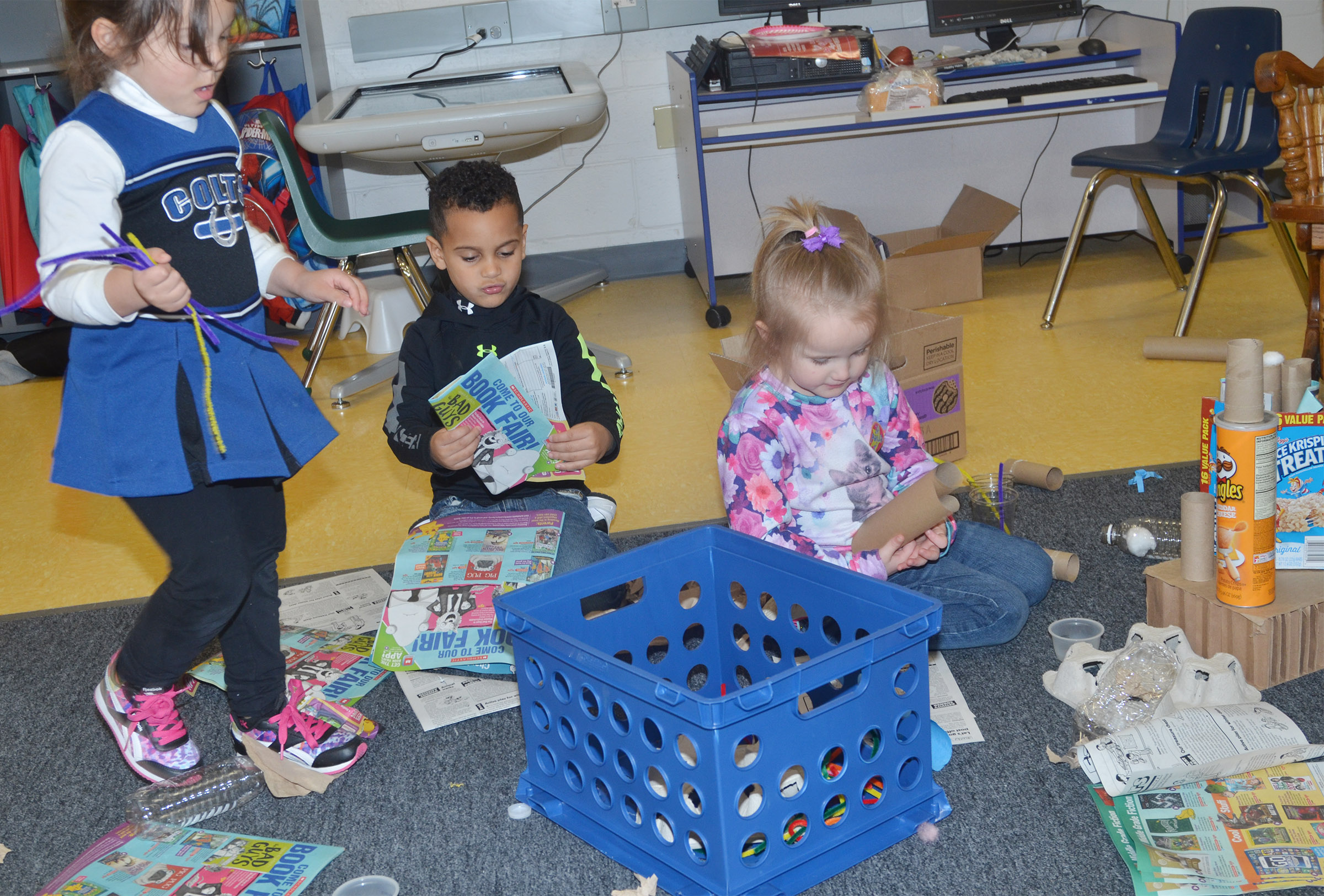 CES preschool students, from left, Addisyn Taylor, Kingston Cowherd and Trinity Dye build.