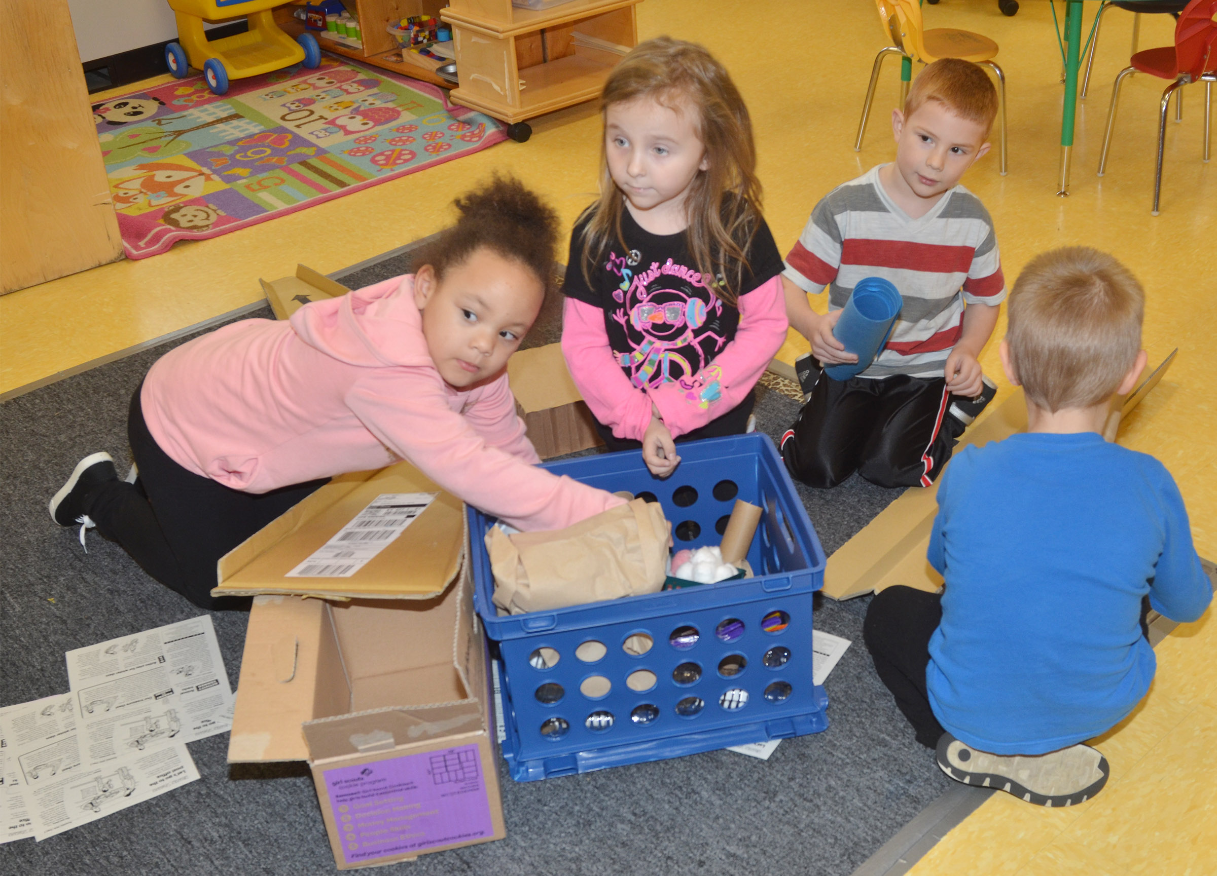 CES preschool students, from left, Lillian Merriweather, Tabitha Leggett, Kennon Dotson and Jacob Parrish build with everyday objects.