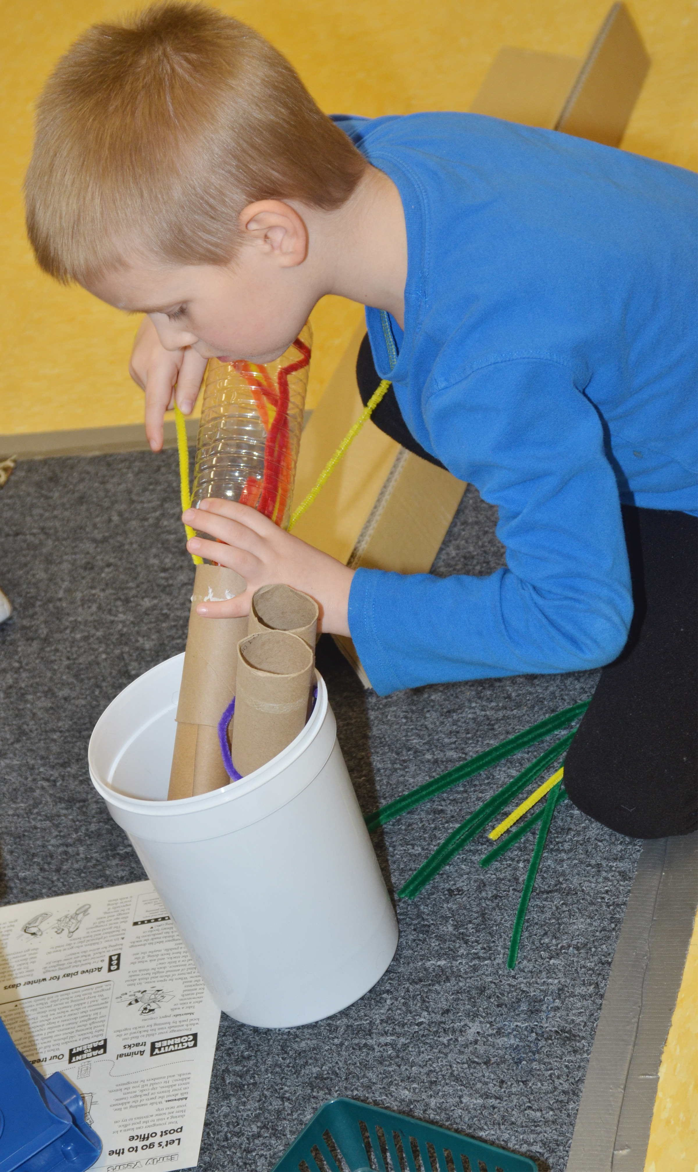 CES preschool student Jacob Parrish searches for objects in which to build.