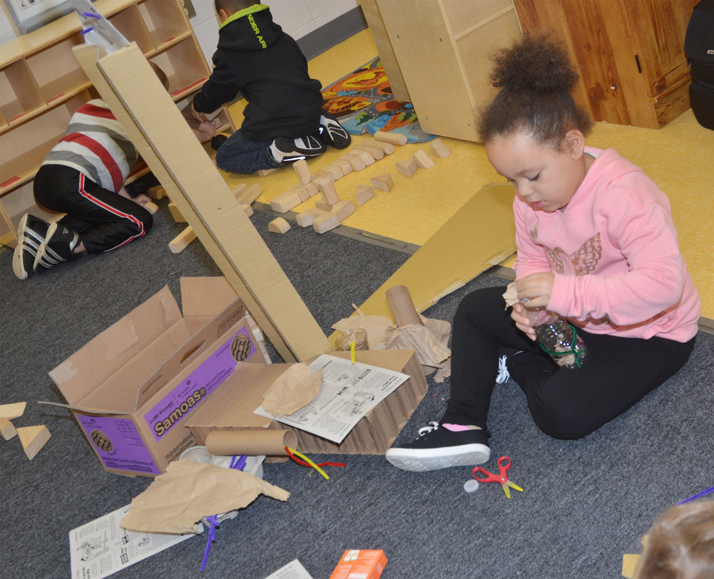 CES preschool student Lillian Merriweather builds.