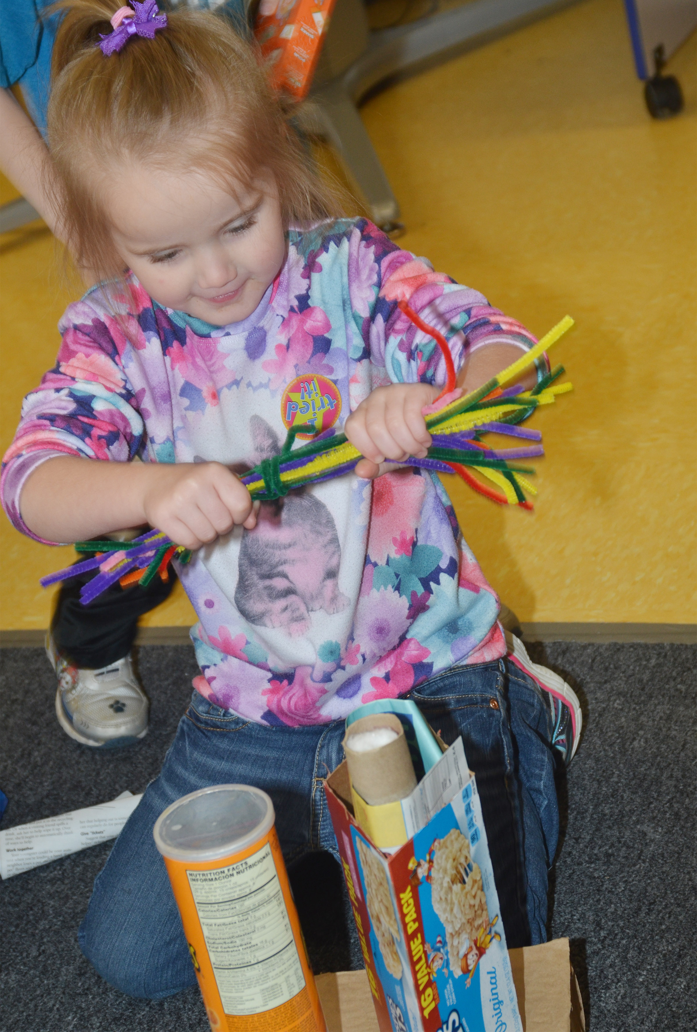 CES preschool student Trinity Dye builds with pipe cleaners.