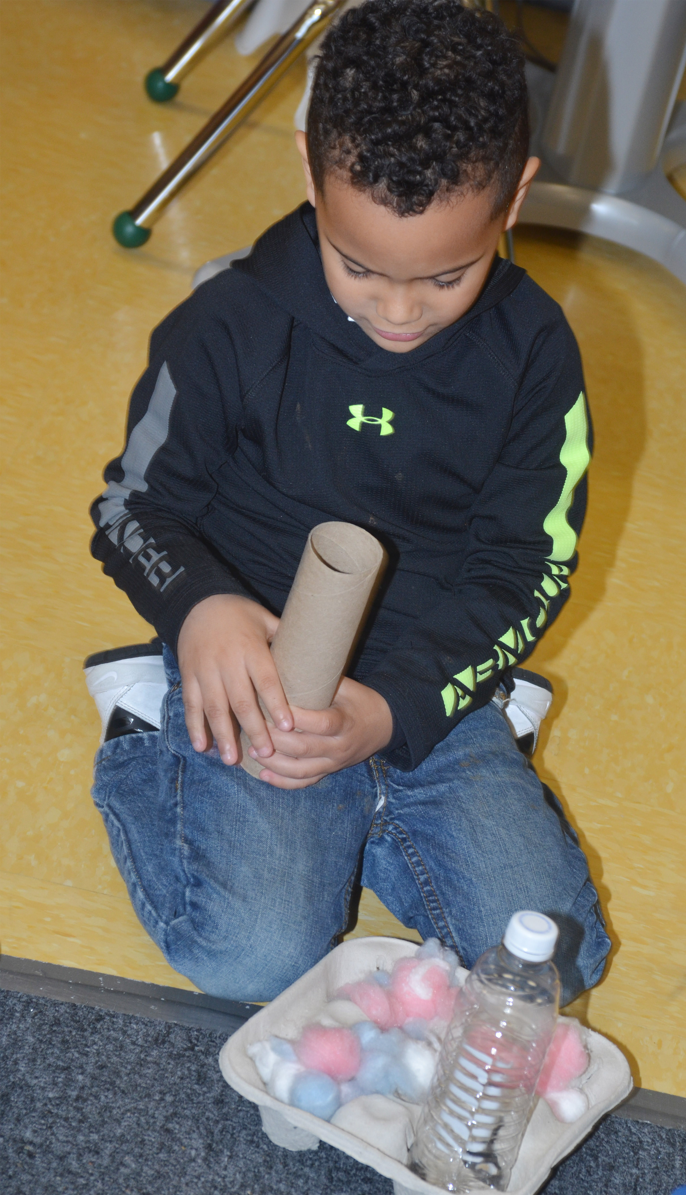 CES preschool student Kingston Cowherd builds with everyday objects.