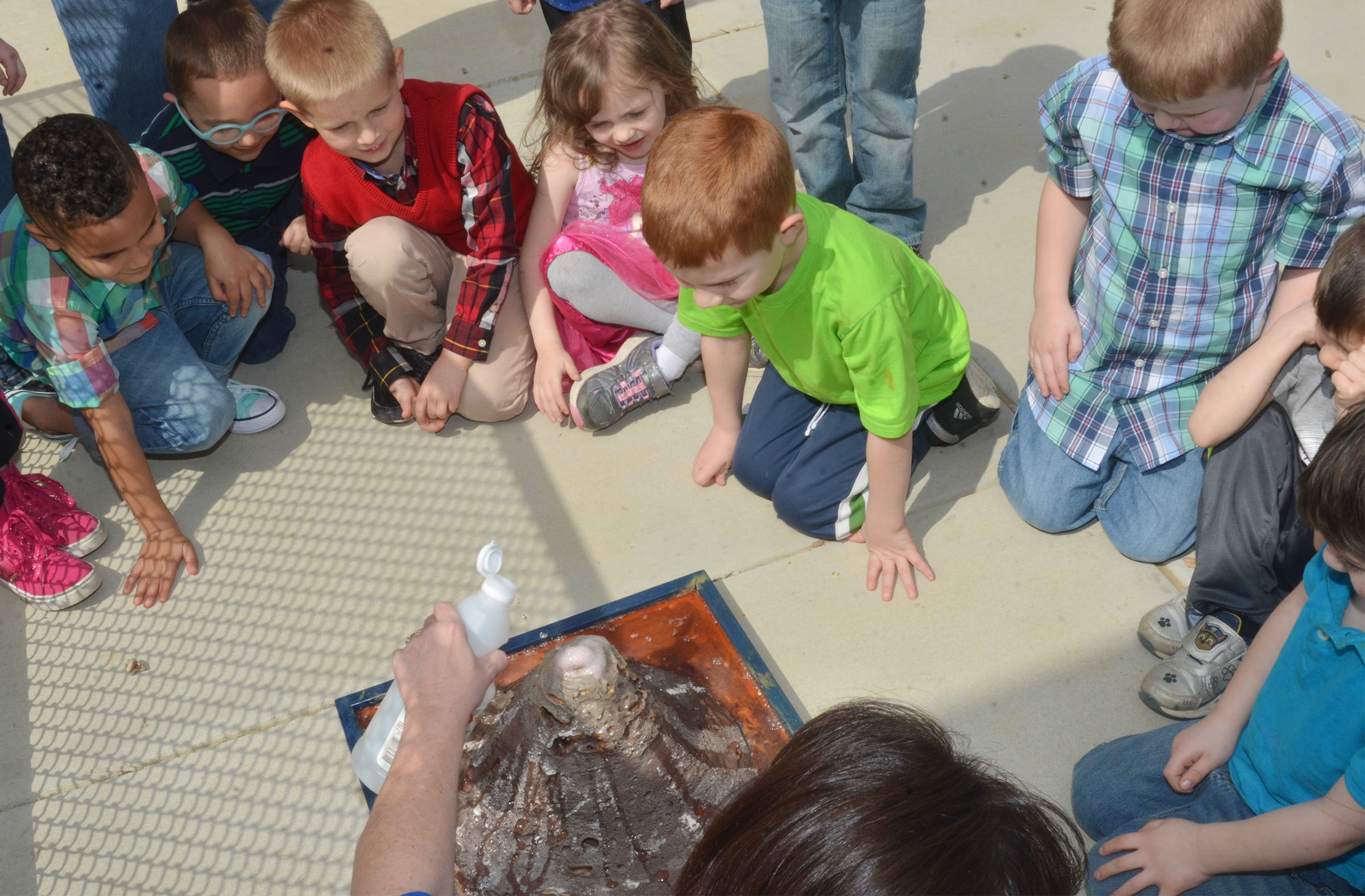 CES preschool students watch as the volcano erupts.