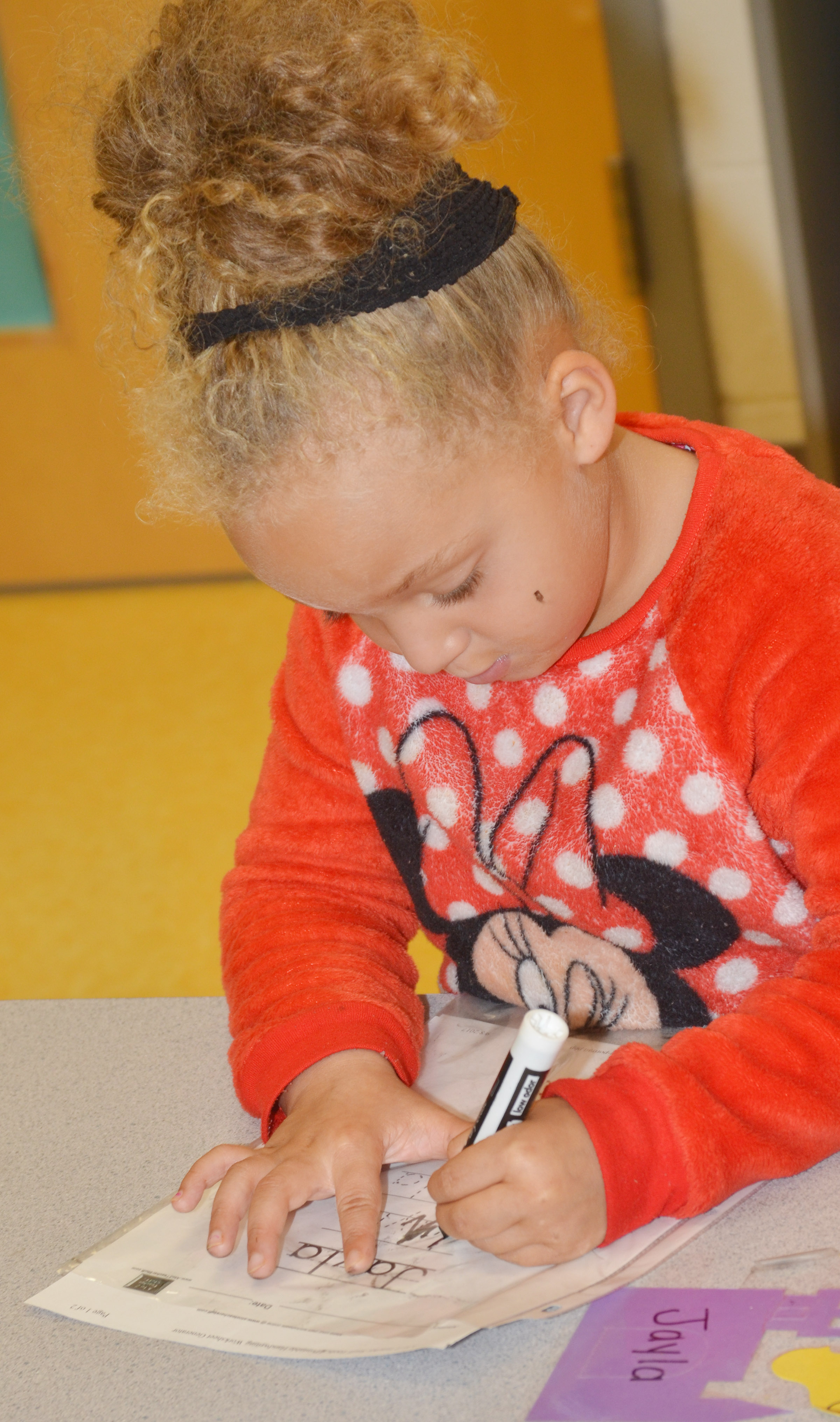 CES preschool student Jayla Barbee practices writing her name.