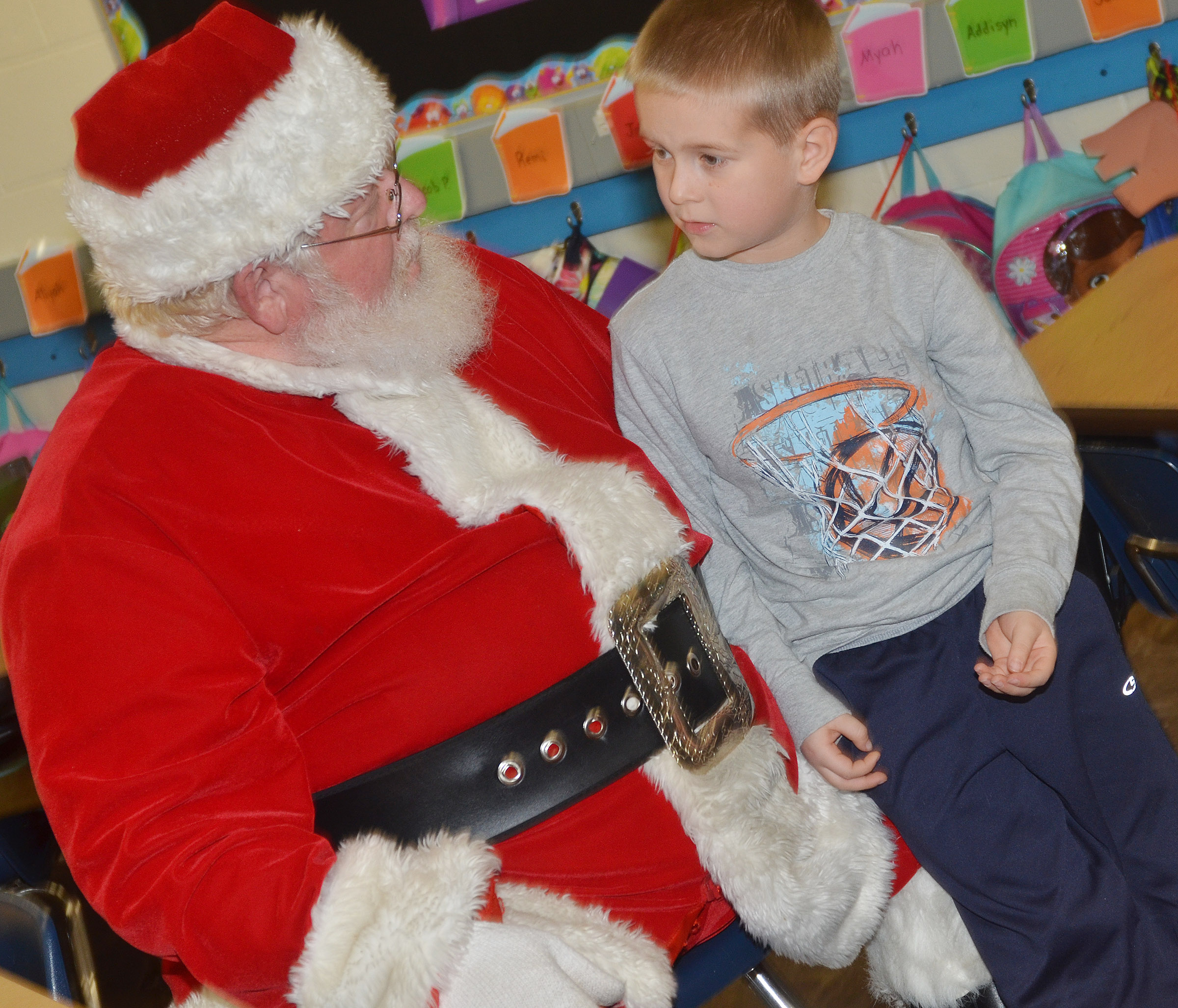CES kindergartener Jacob Parrish talks to Santa.