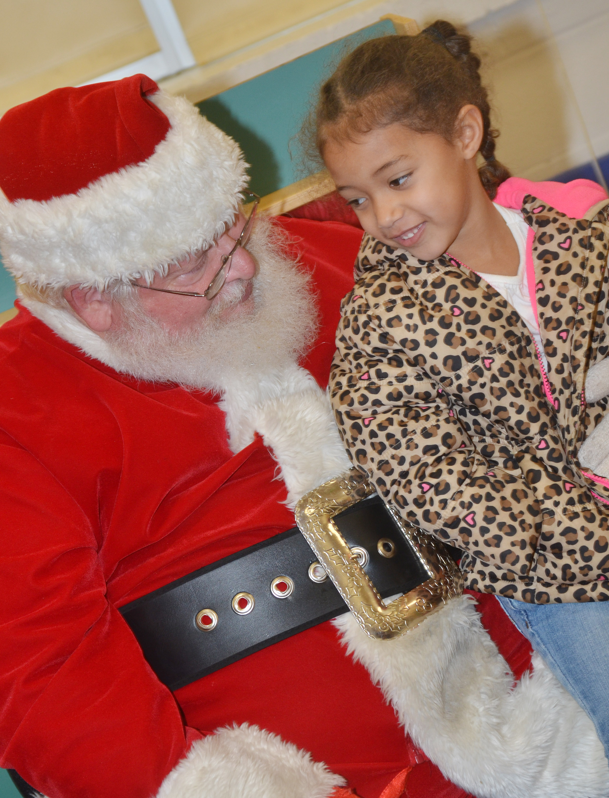 CES preschool student Onyx Hunter talks to Santa.