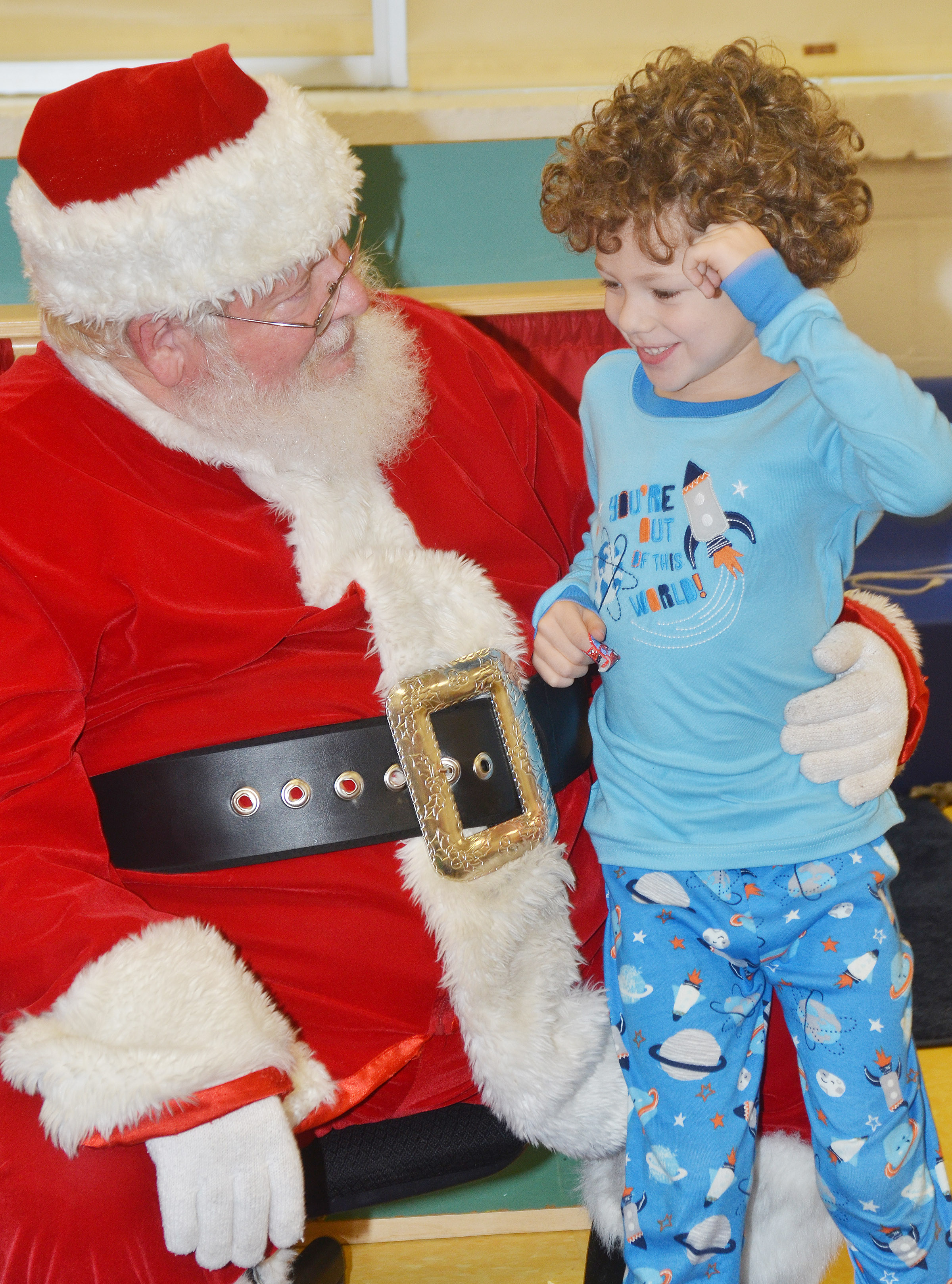 CES preschool student Zyron Young talks to Santa.