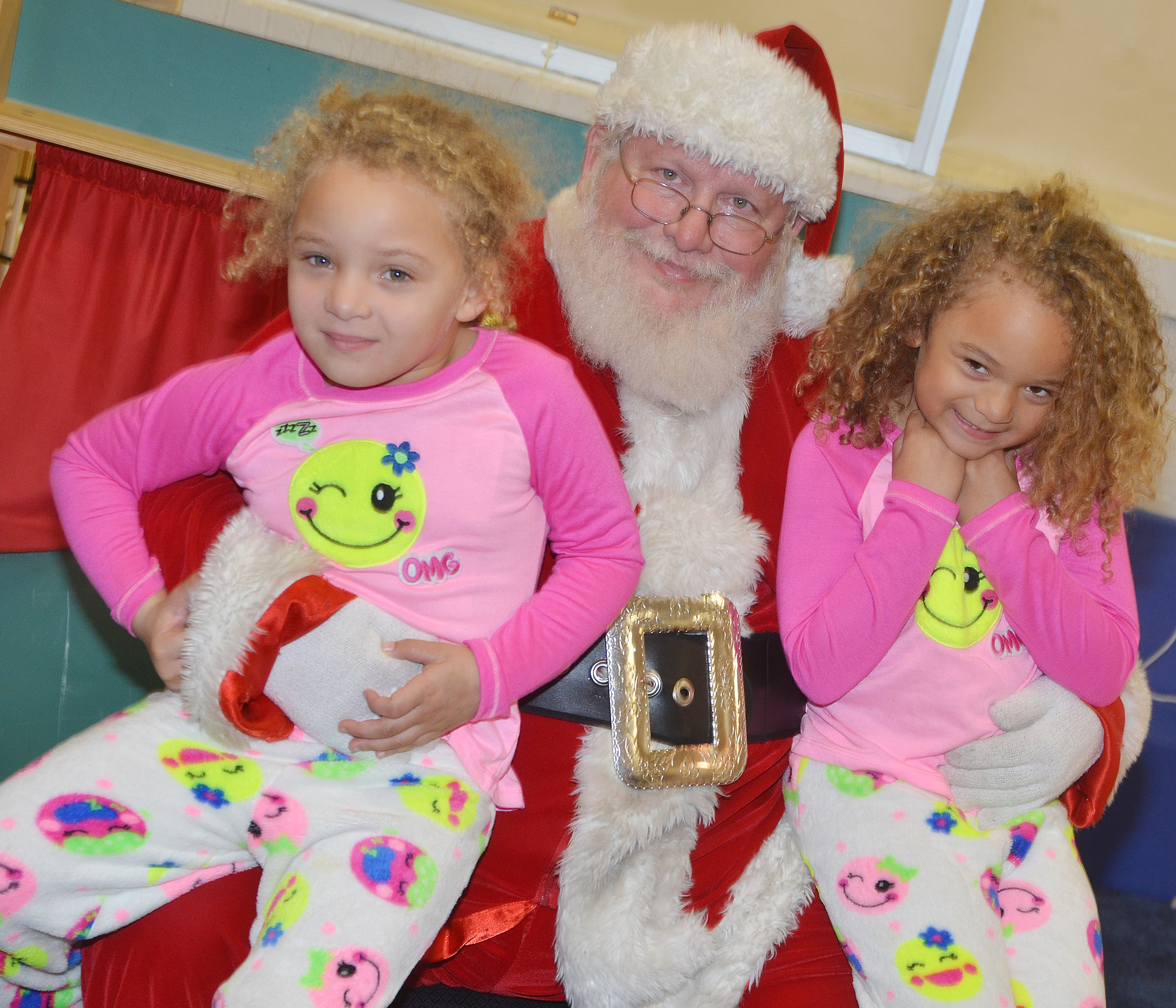 CES preschool students Jayla Barbee, at left, and Layla Barbee smile for a photo with Santa.