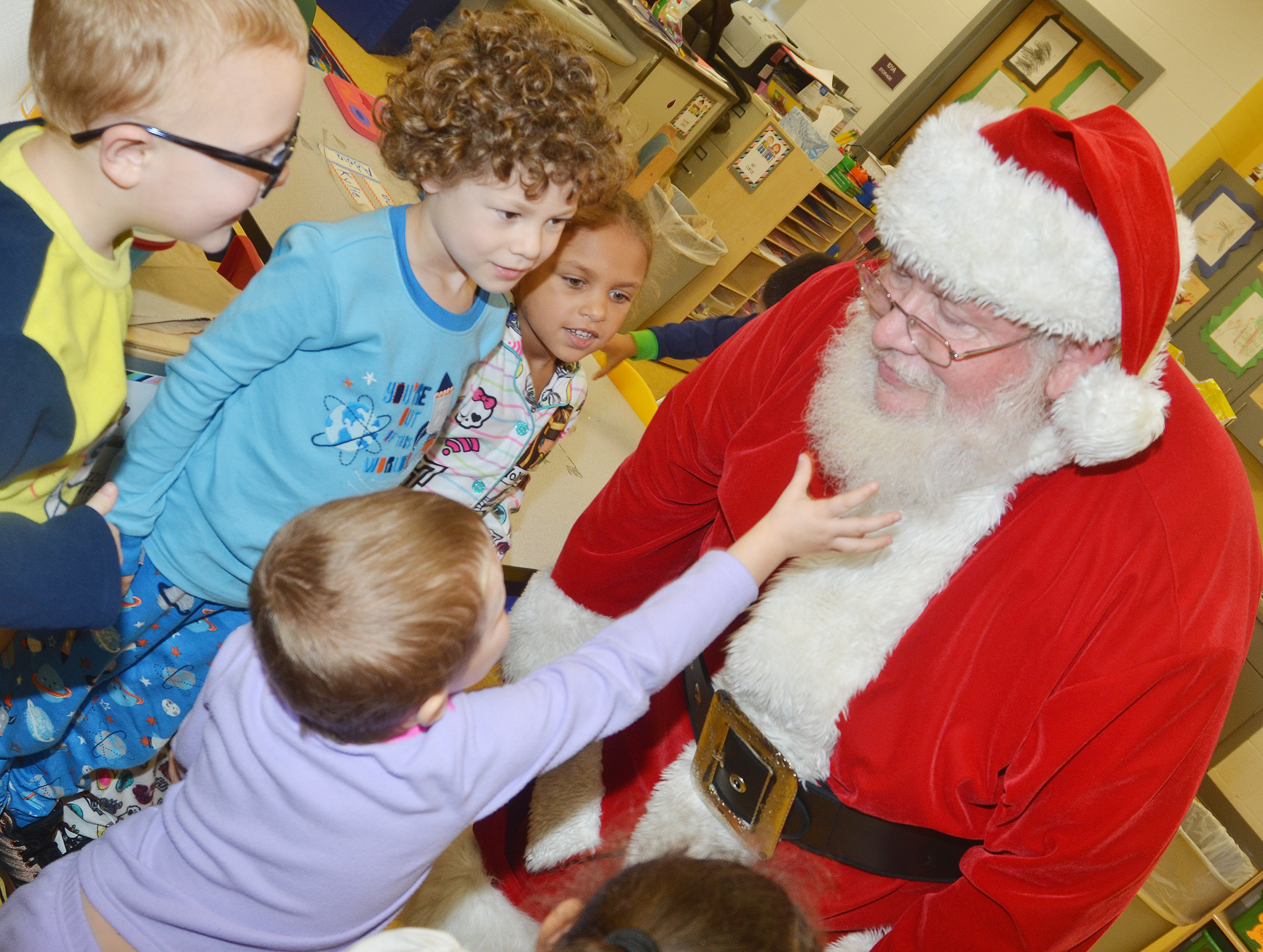 CES preschool students see if Santa's beard is real.