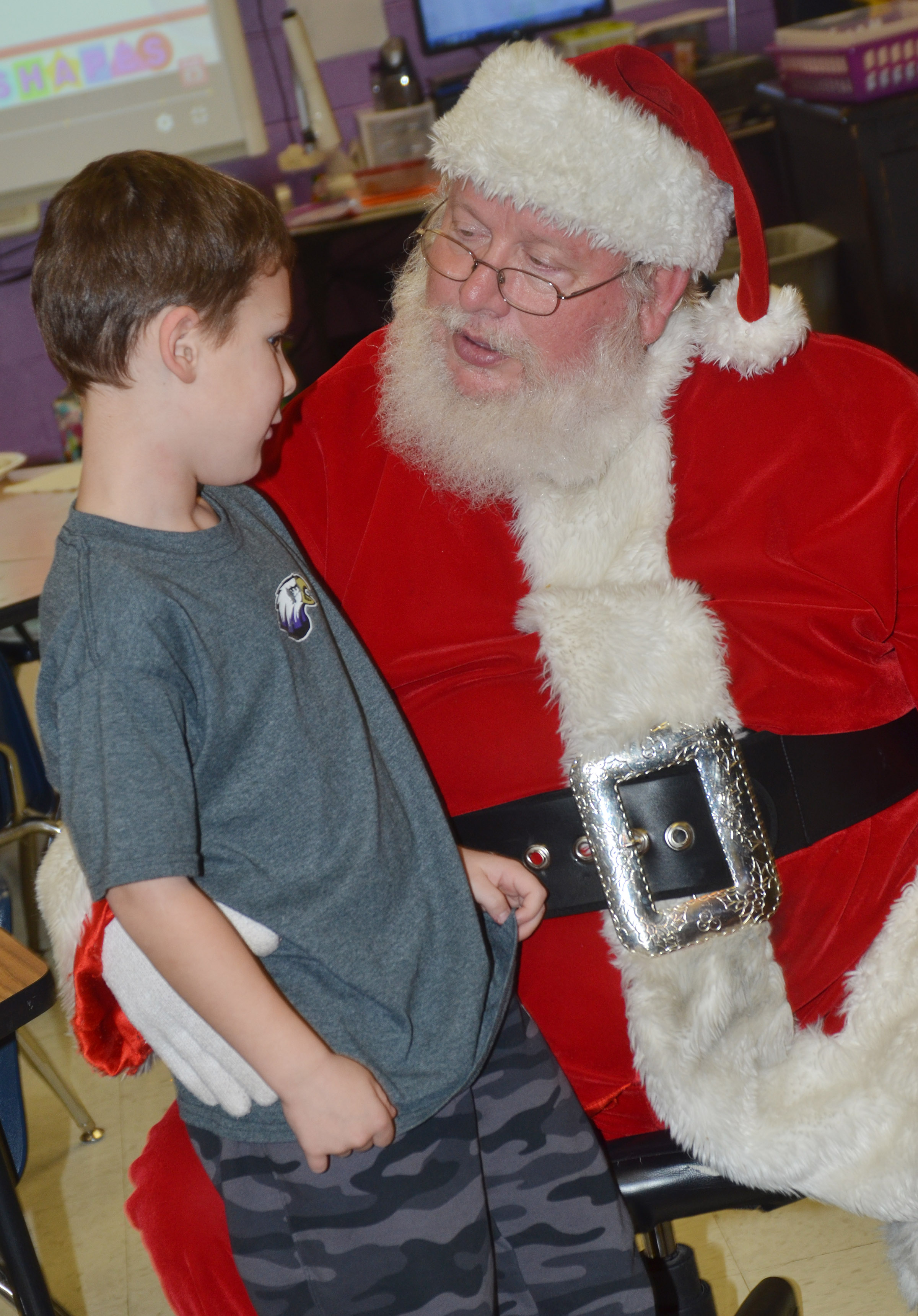 CES kindergartener Kyler Wilson talks to Santa.