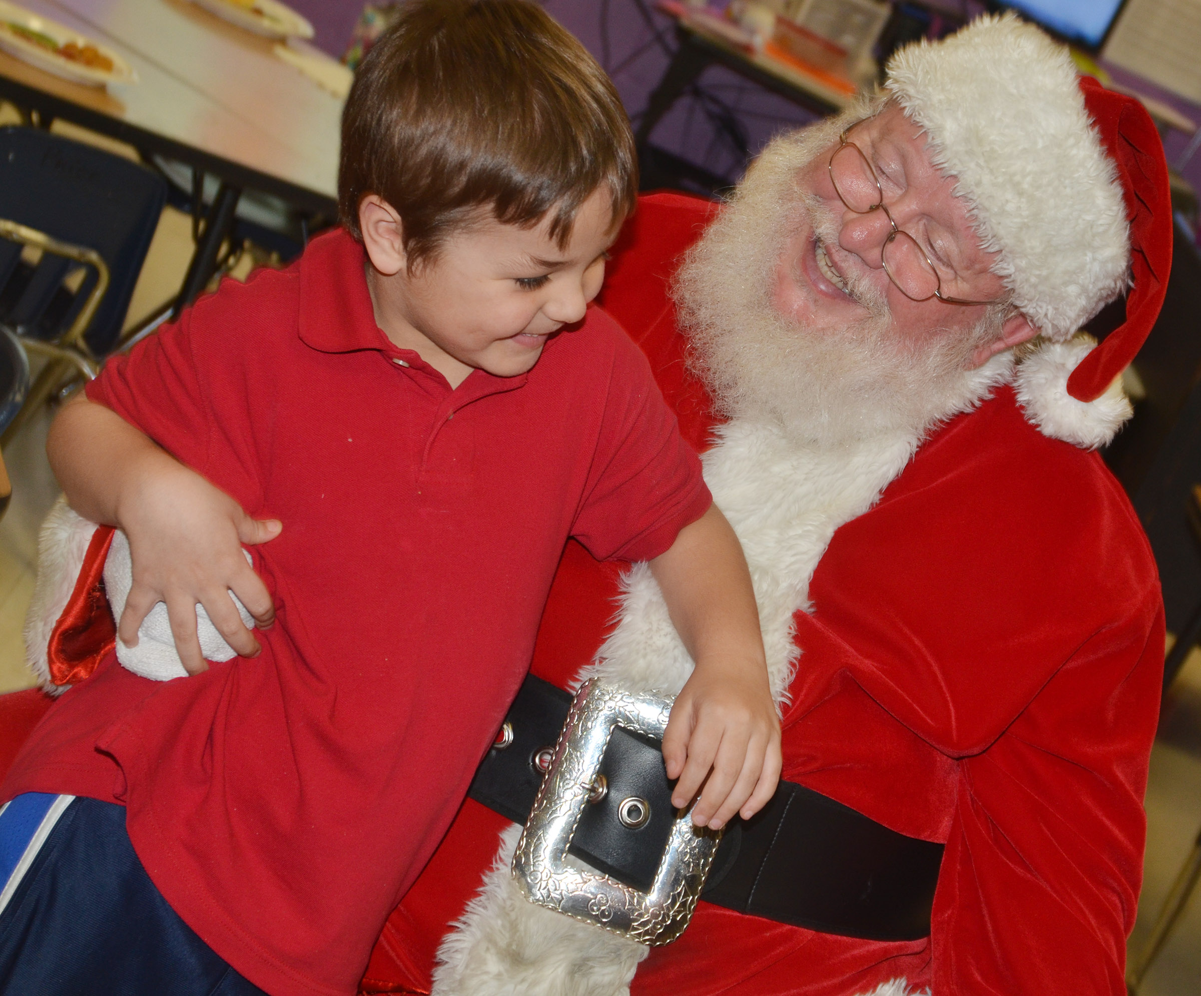 CES kindergartener Matheus Almeida talks to Santa.