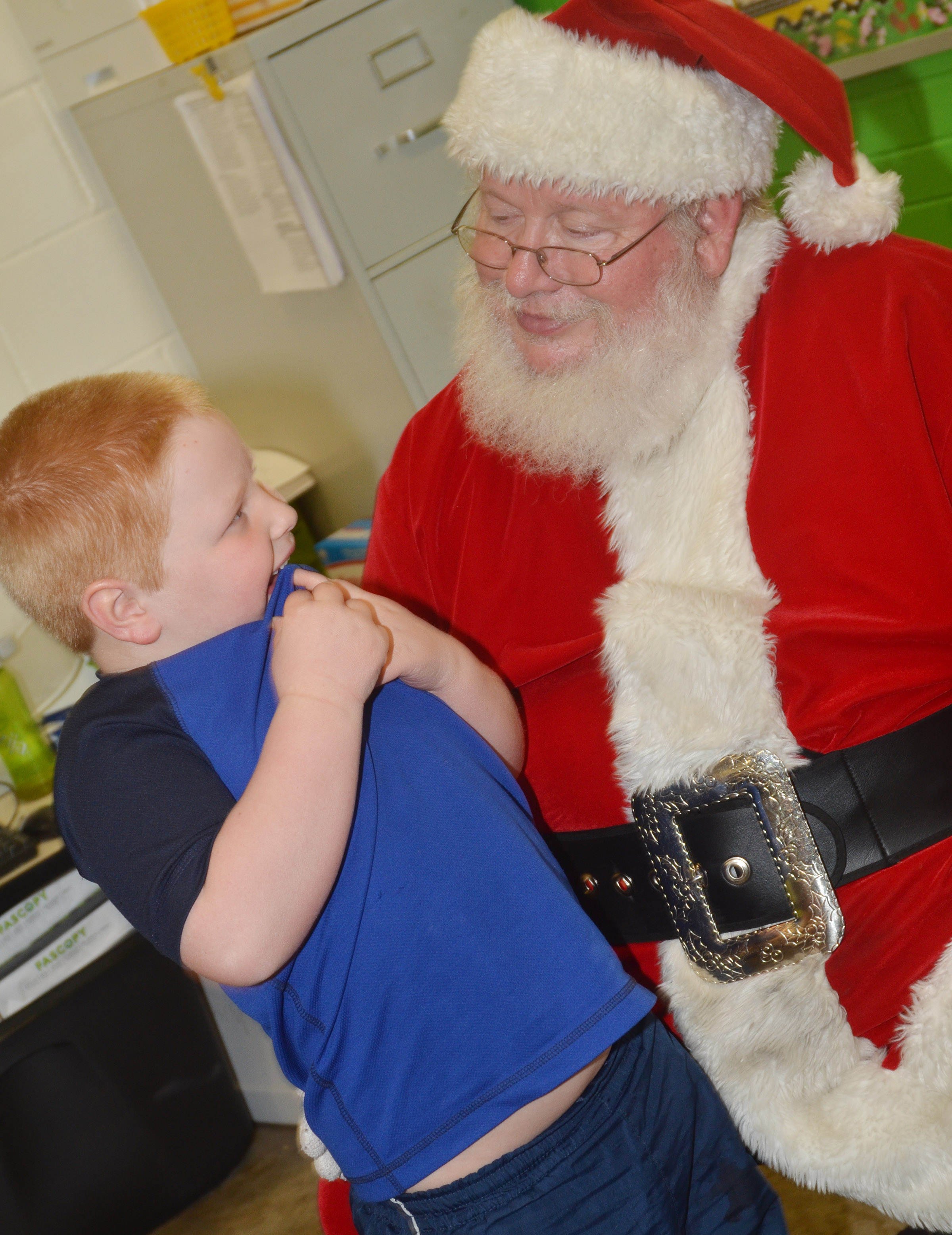 CES kindergartener Konnar Hicks talks to Santa.