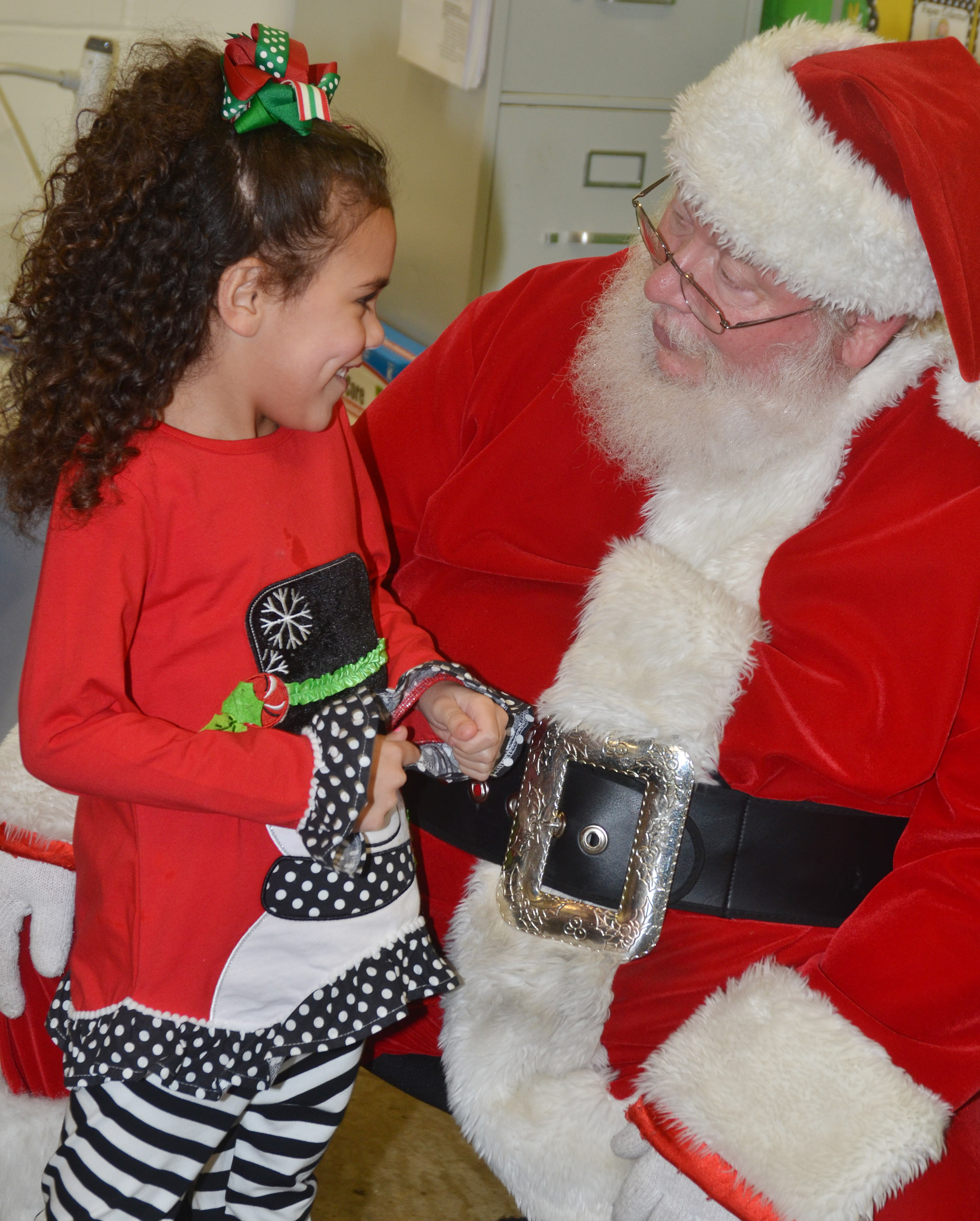 CES kindergartener Adelyn Litsey talks to Santa.