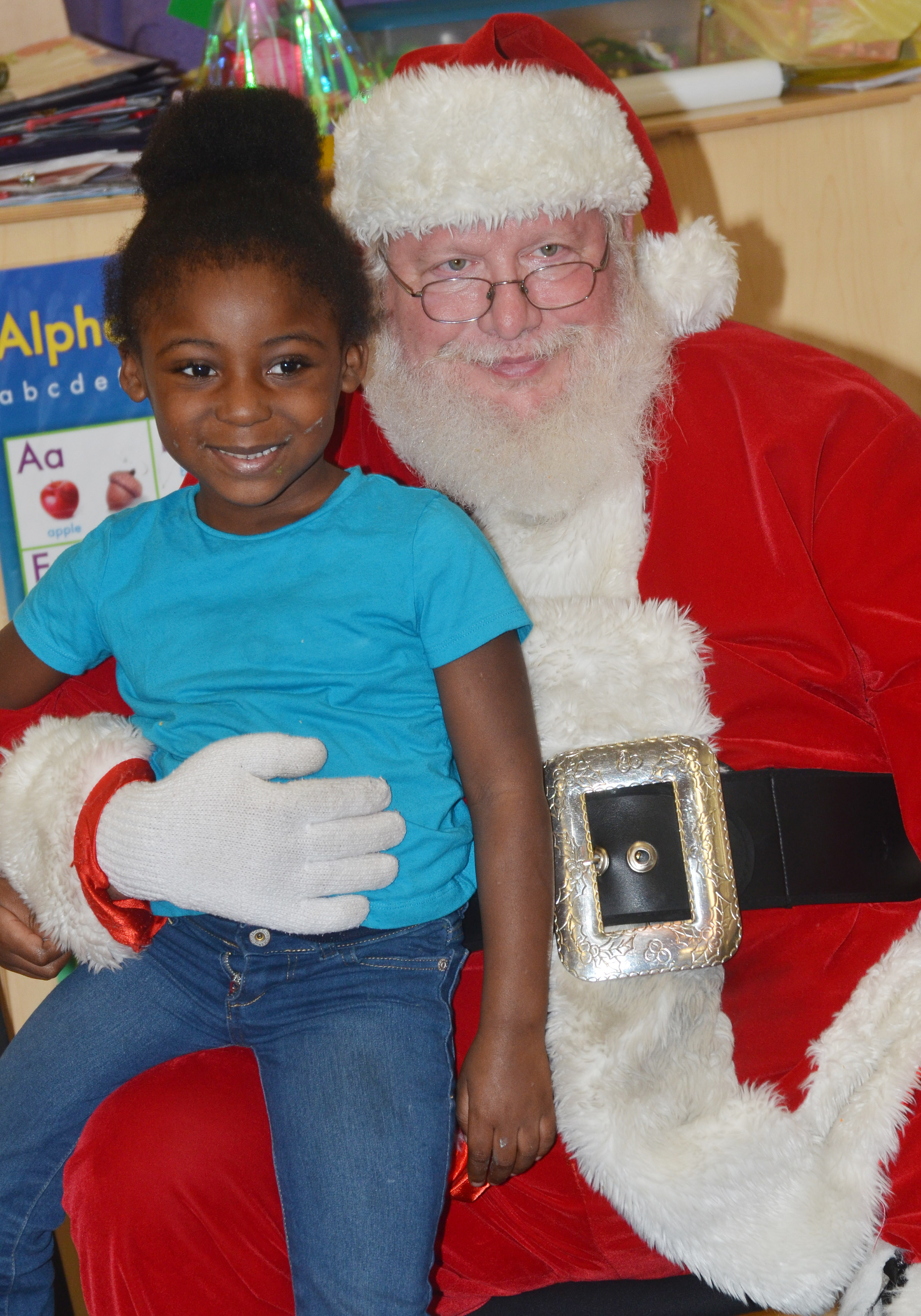 CES preschool student Harmony Brown smiles for a photo with Santa.
