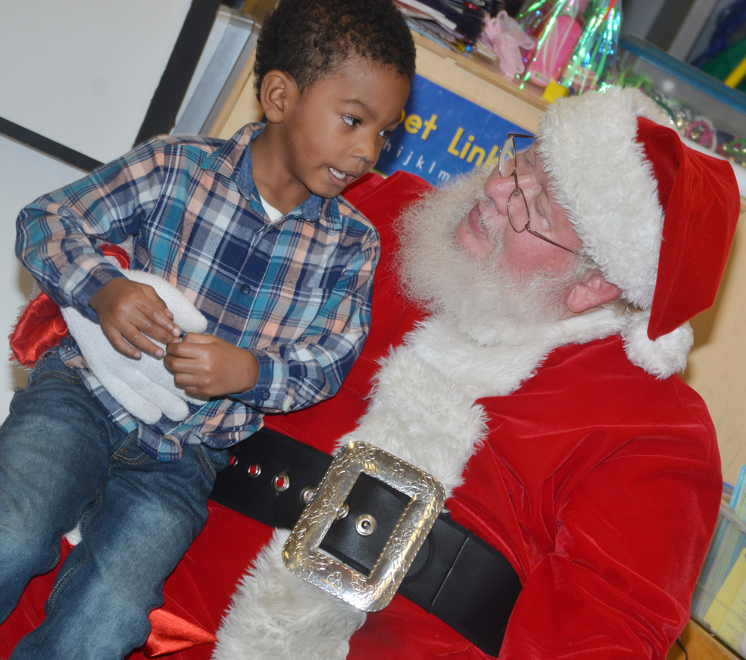 CES preschool student Rakim Dunn talks to Santa.