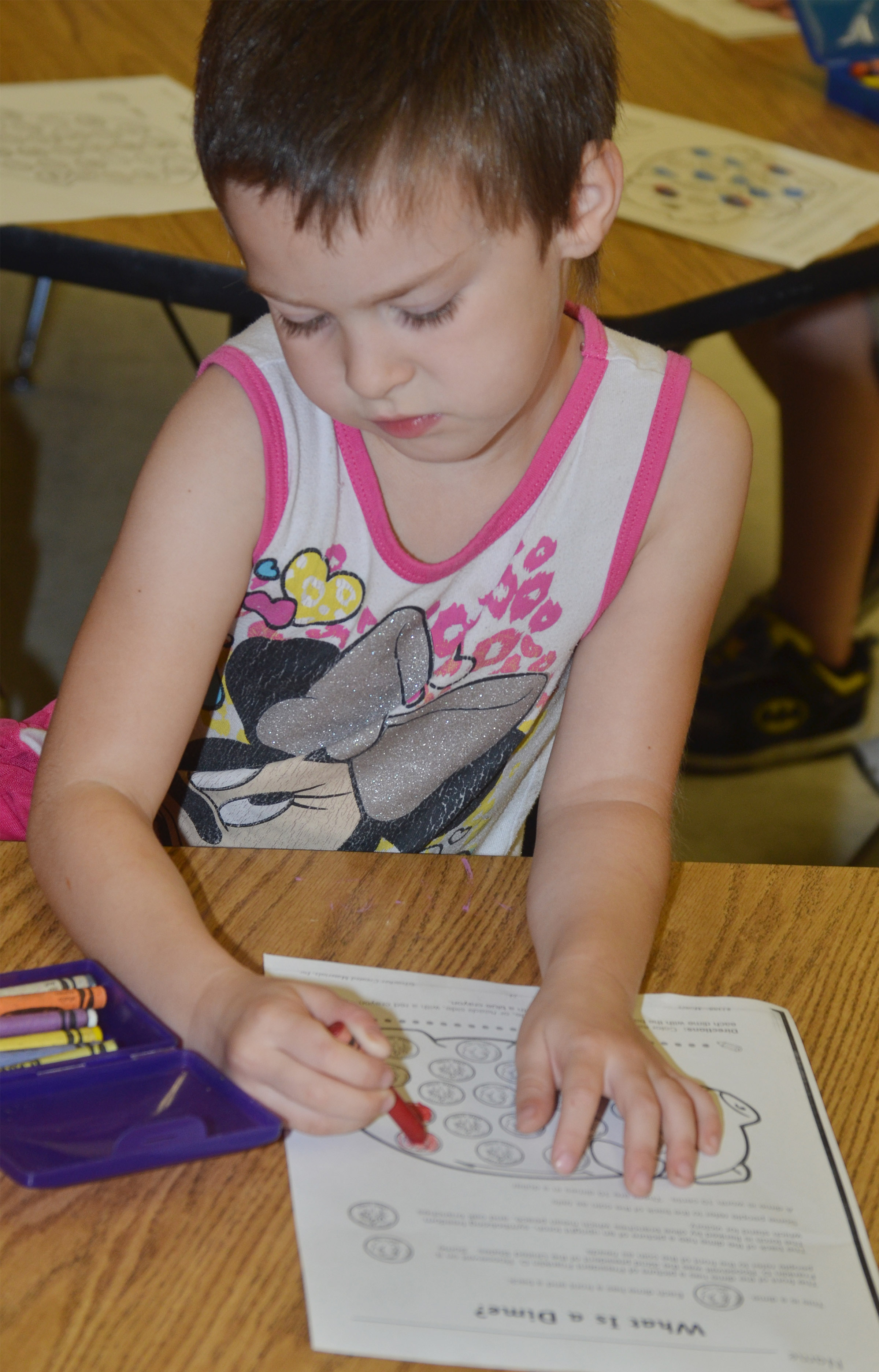 CES kindergartener Madison Haywood colors dimes.