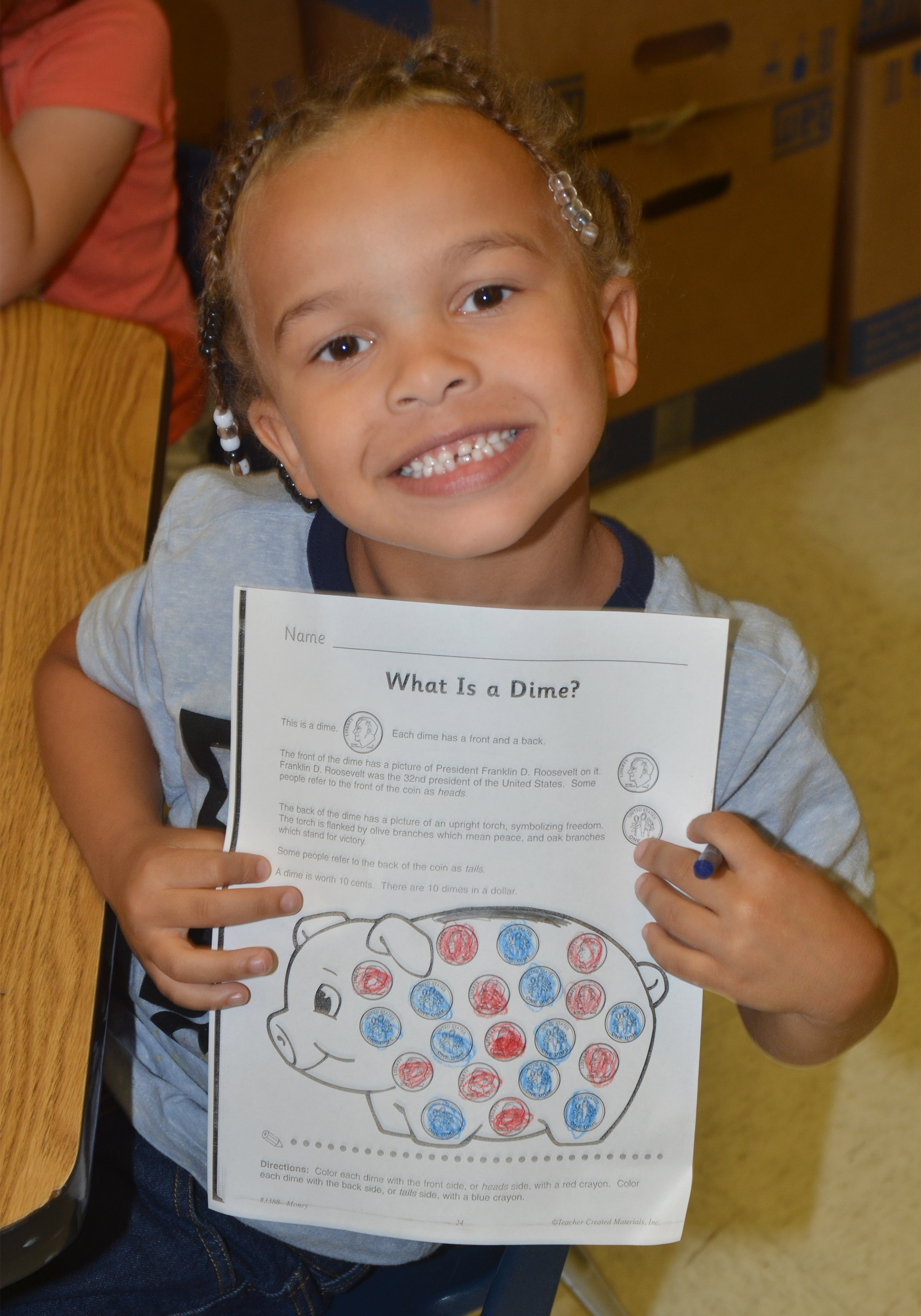 CES kindergartener Dyra Welch colors dimes.