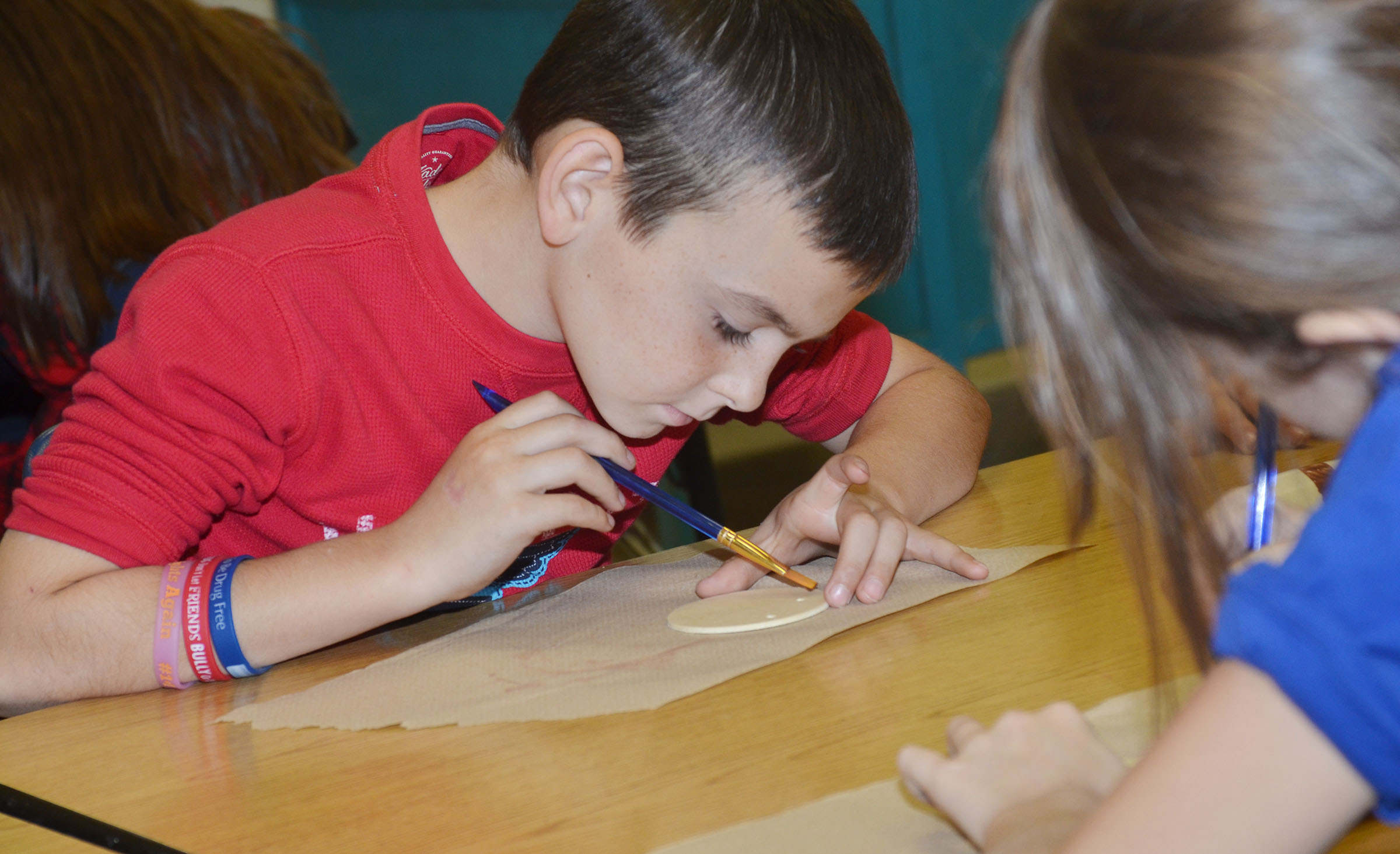 CES second-grader Hunter Garmon carefully paints his ornament.