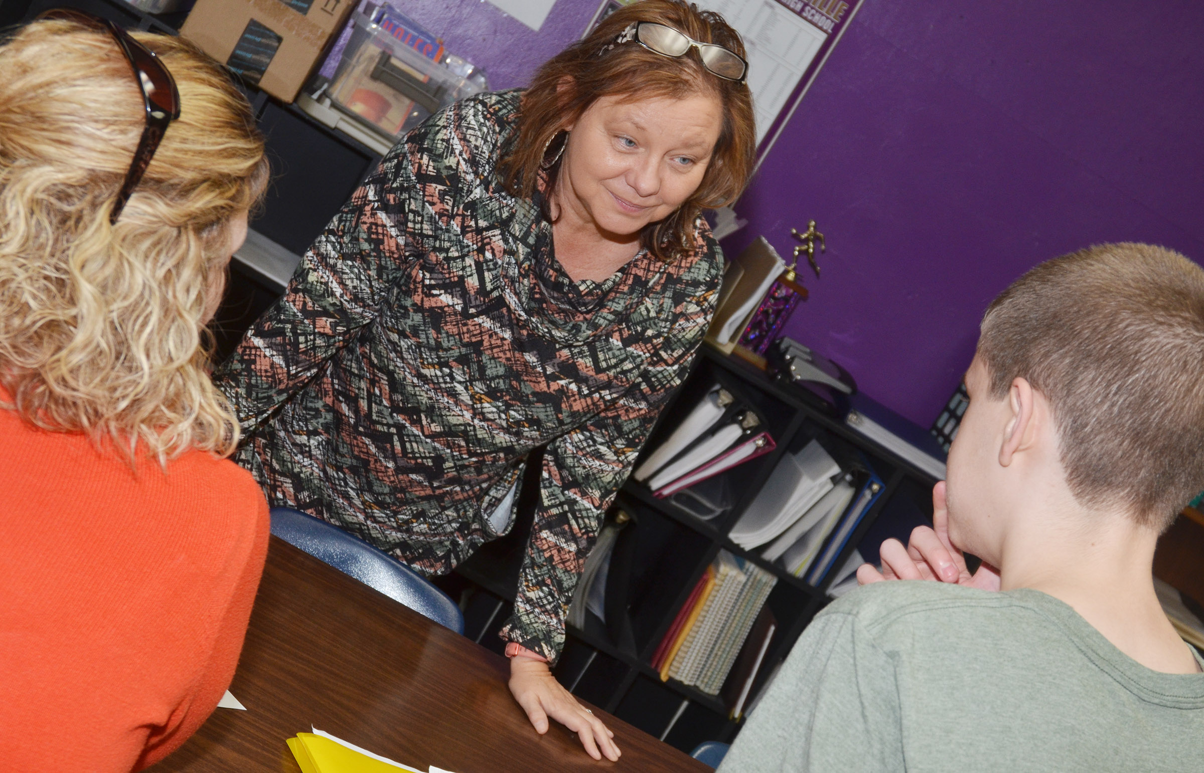 CMS seventh-grade teacher Sharon Harris talks with her students.