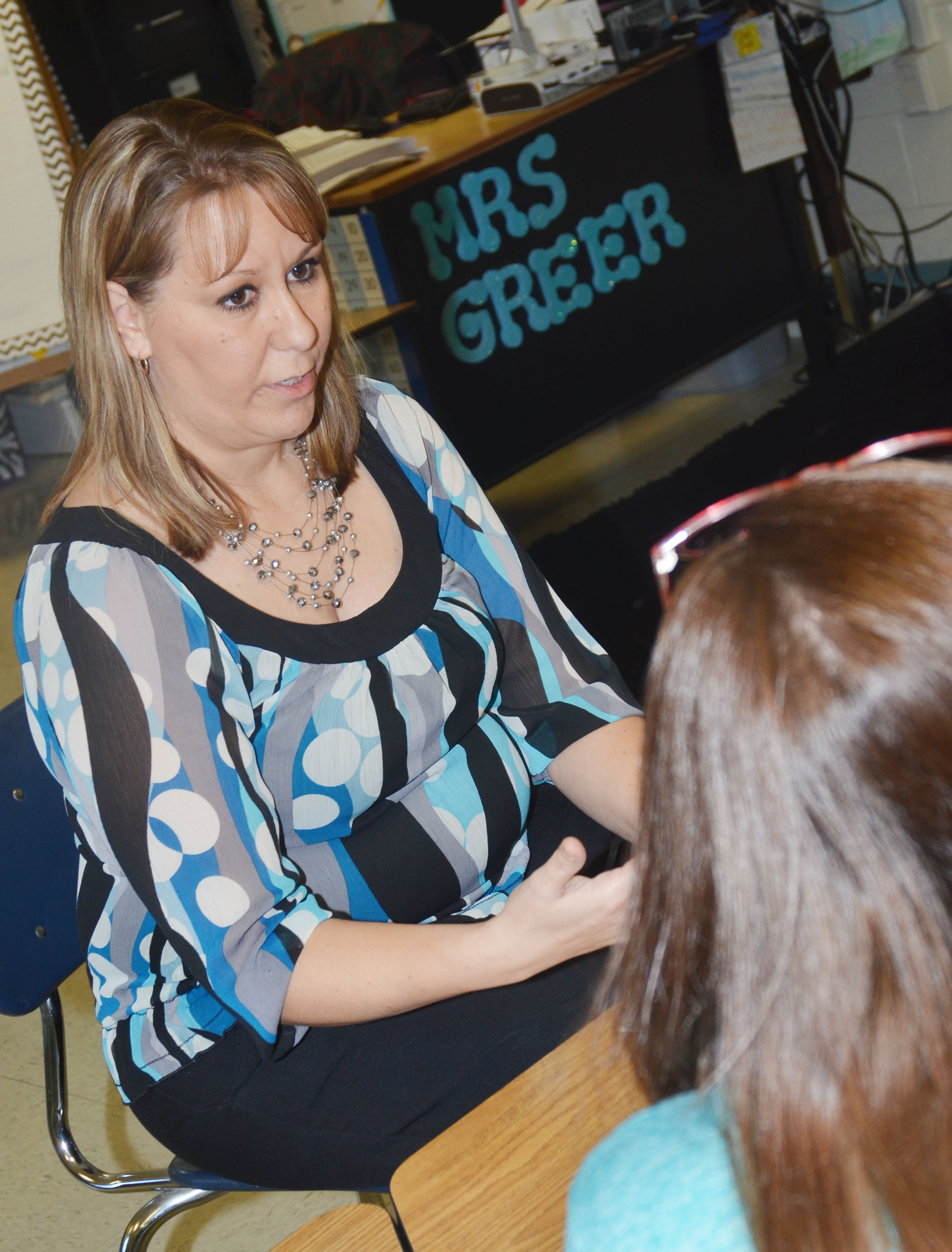 CES first-grader teacher Amanda Greer talks with a parent.