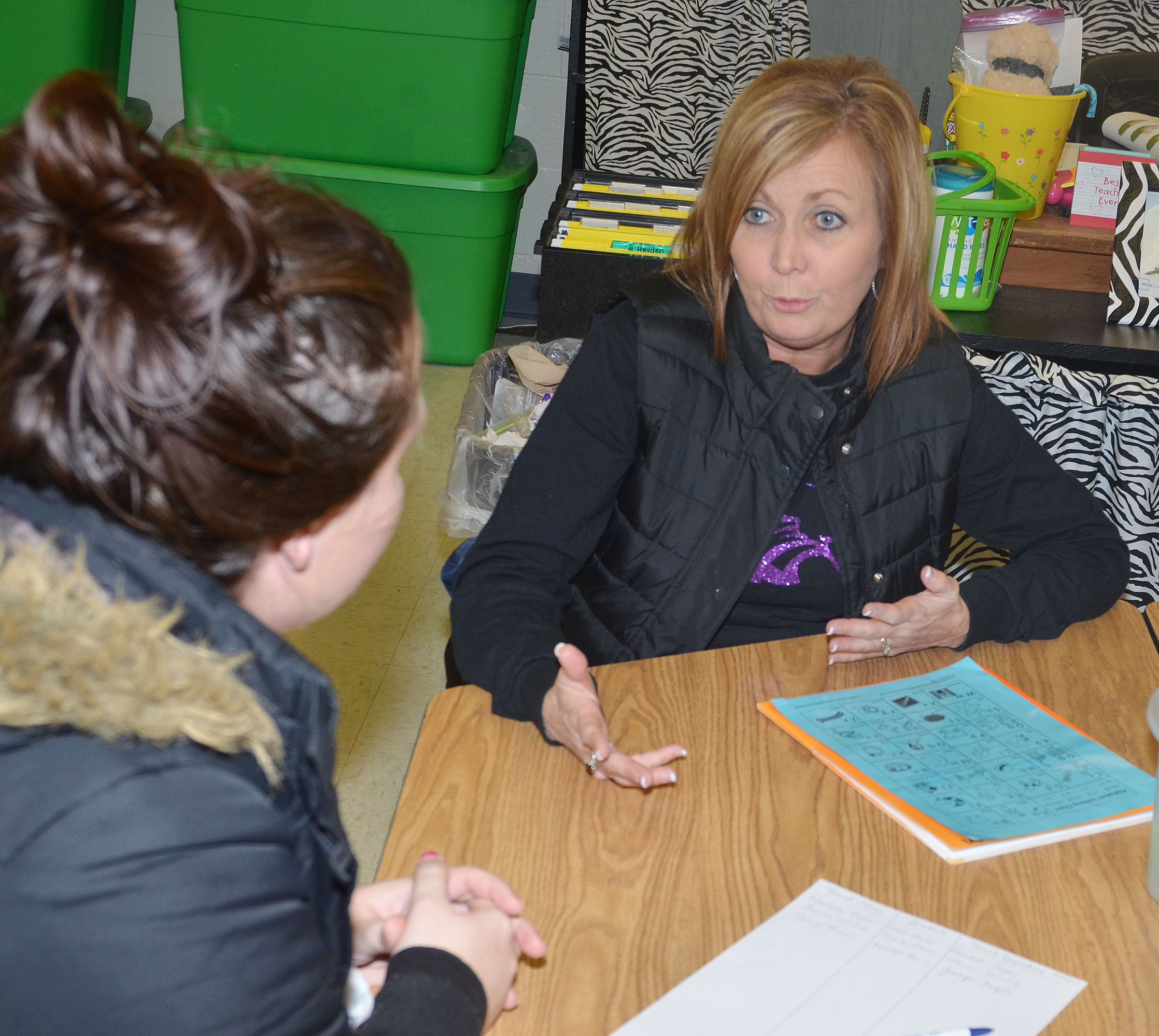 CES kindergartener Lisa Wiseman talks with a parent.