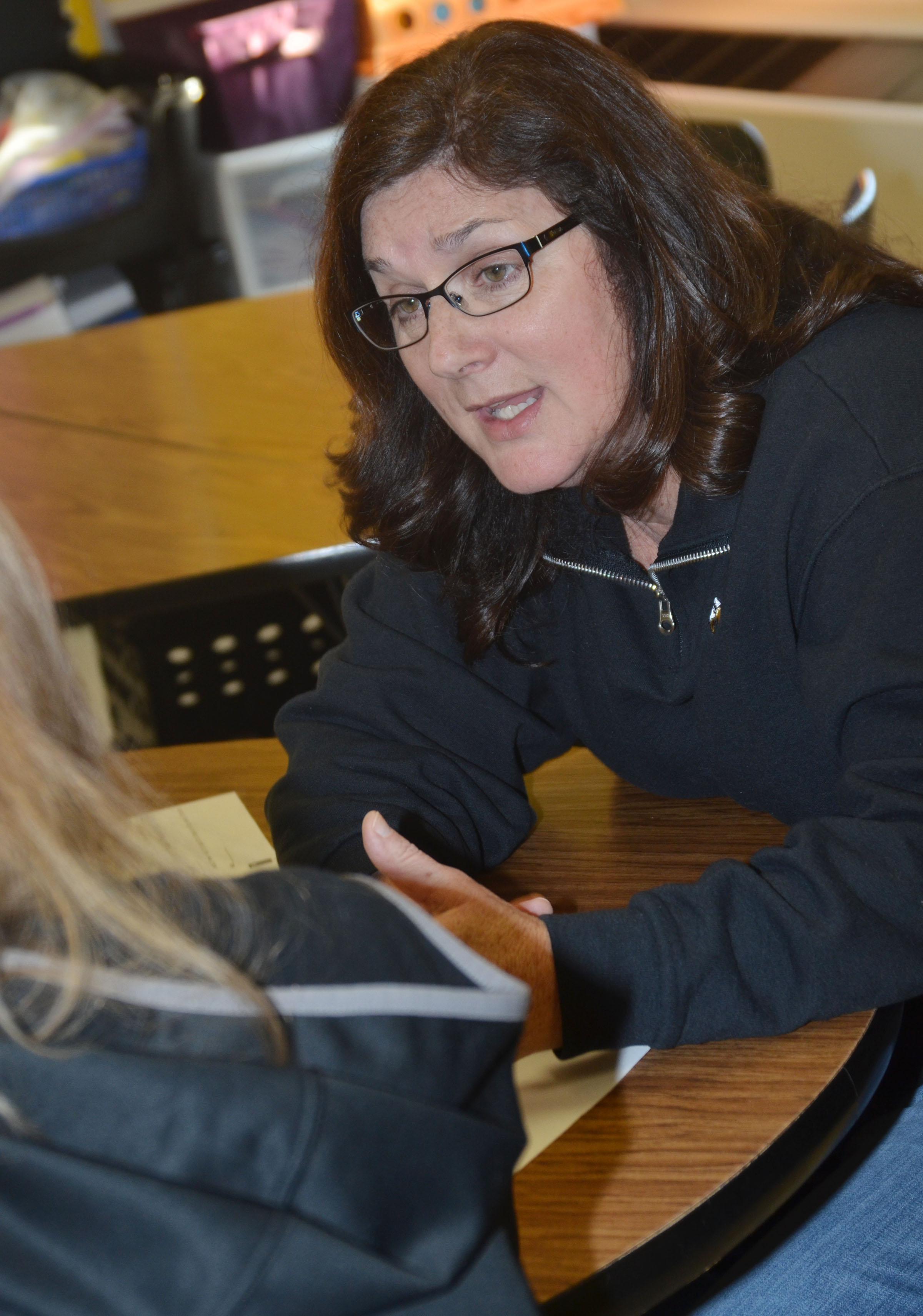 CES third-grade teacher Patty Haley talks with a parent.
