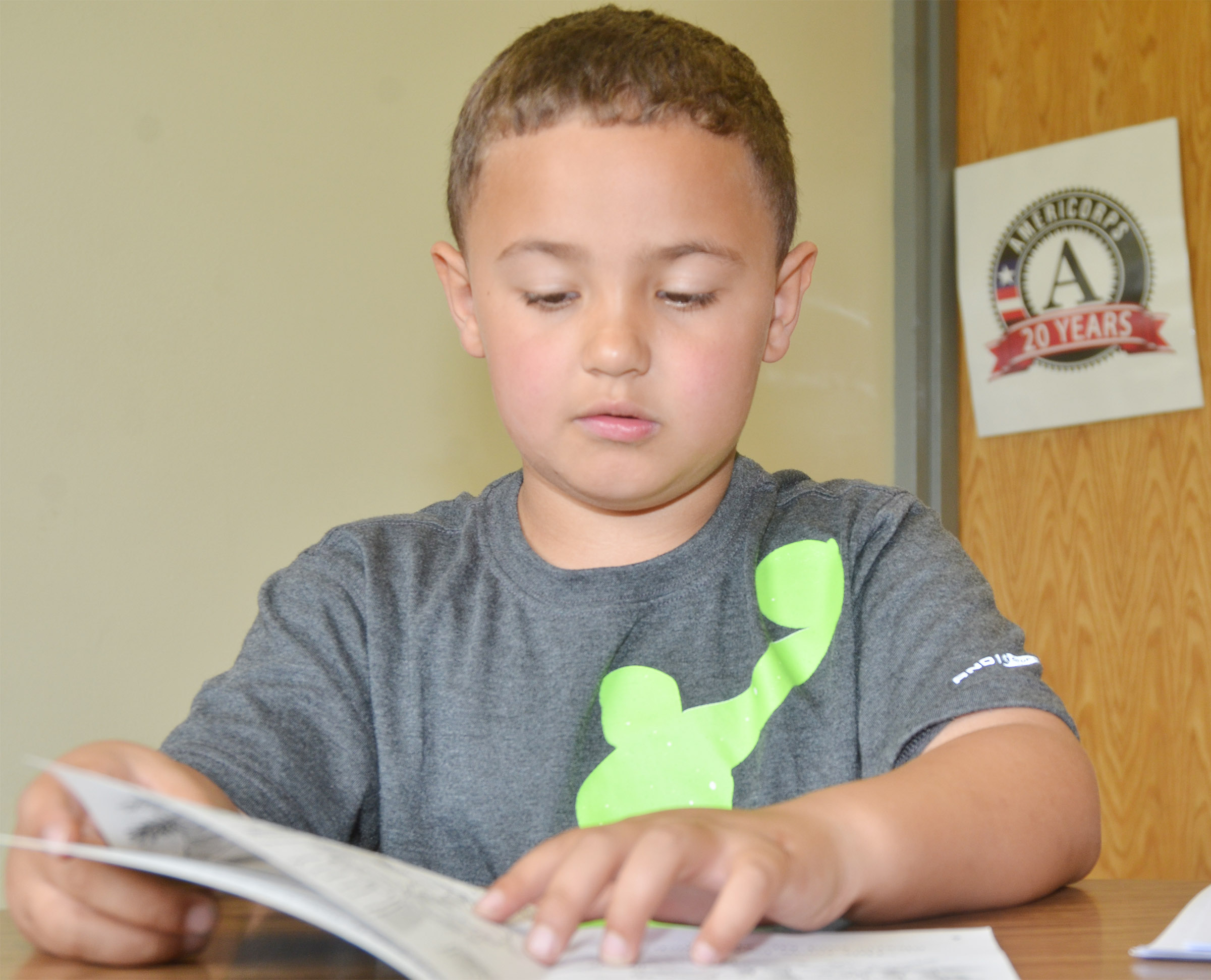 CES first-grader Marion Mann reads with his group.