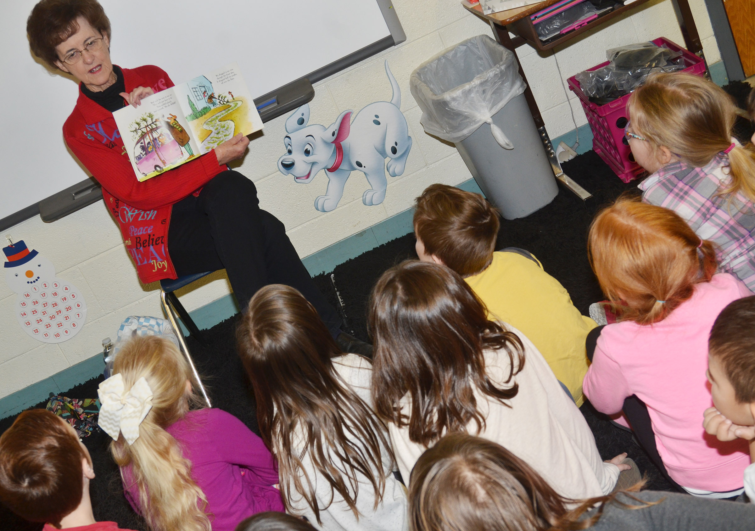 Betty Schuhmann reads to CES first-graders.