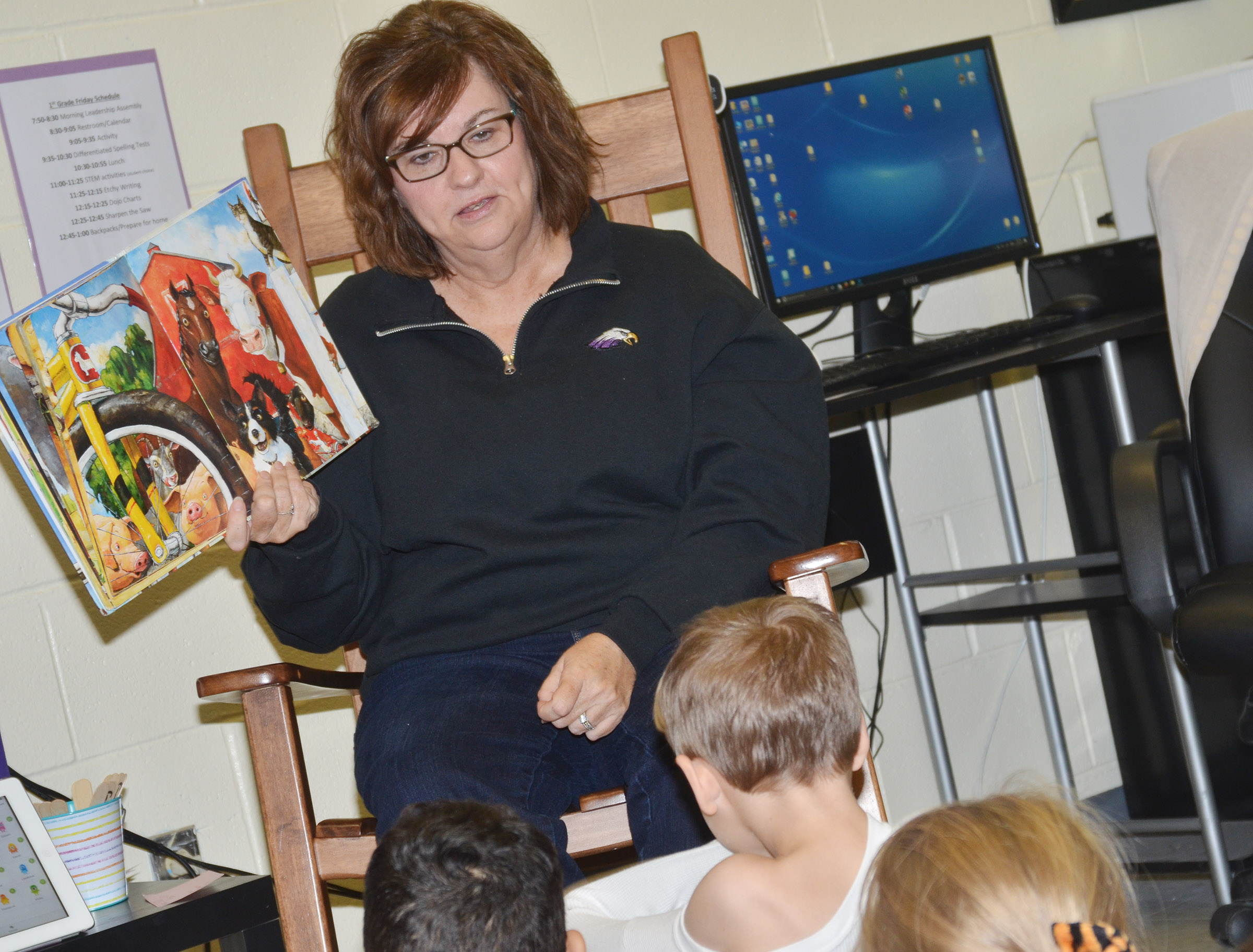 Susan Kennon reads to CES first-graders.