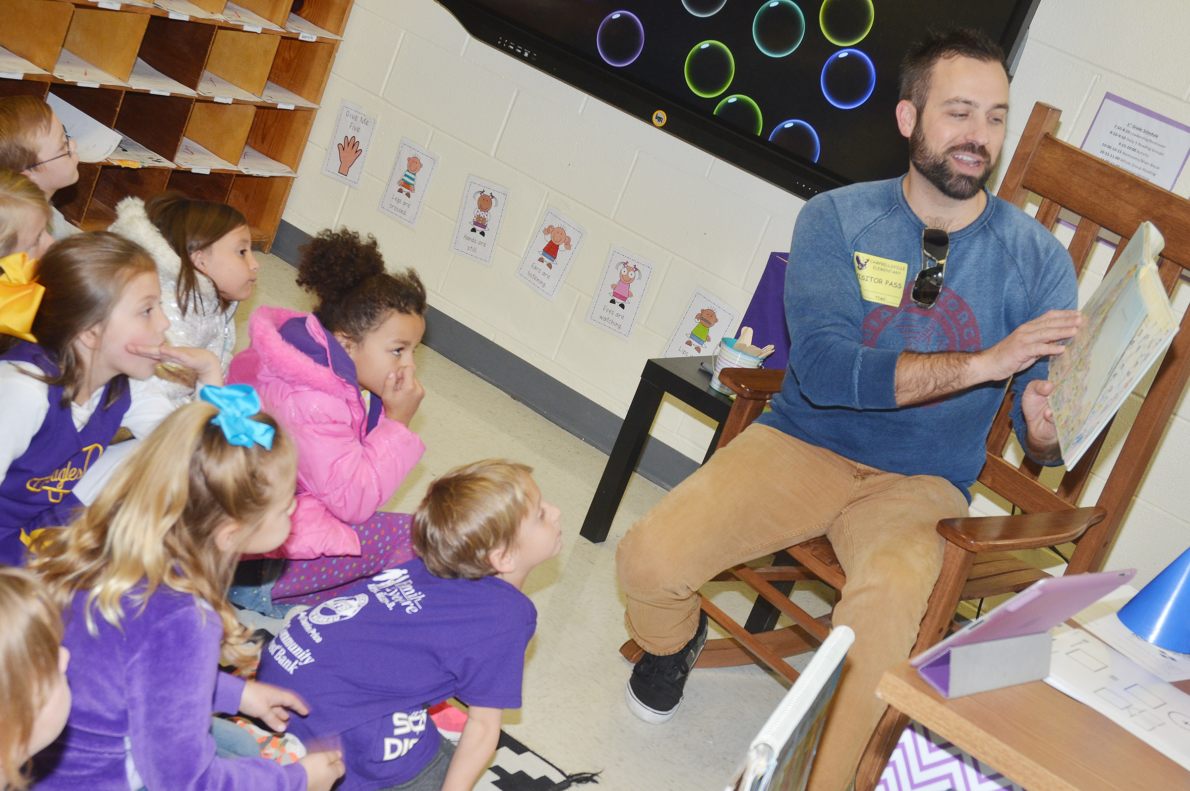 Brent Thompson reads to CES first-graders.