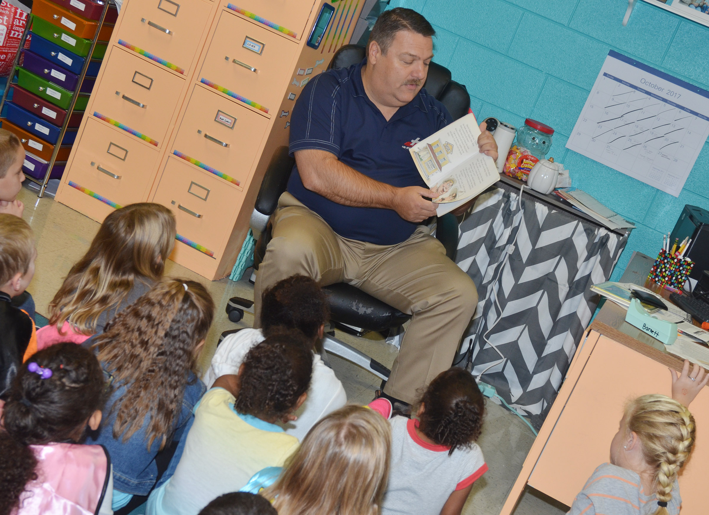 Dan Durham reads to CES first-graders.