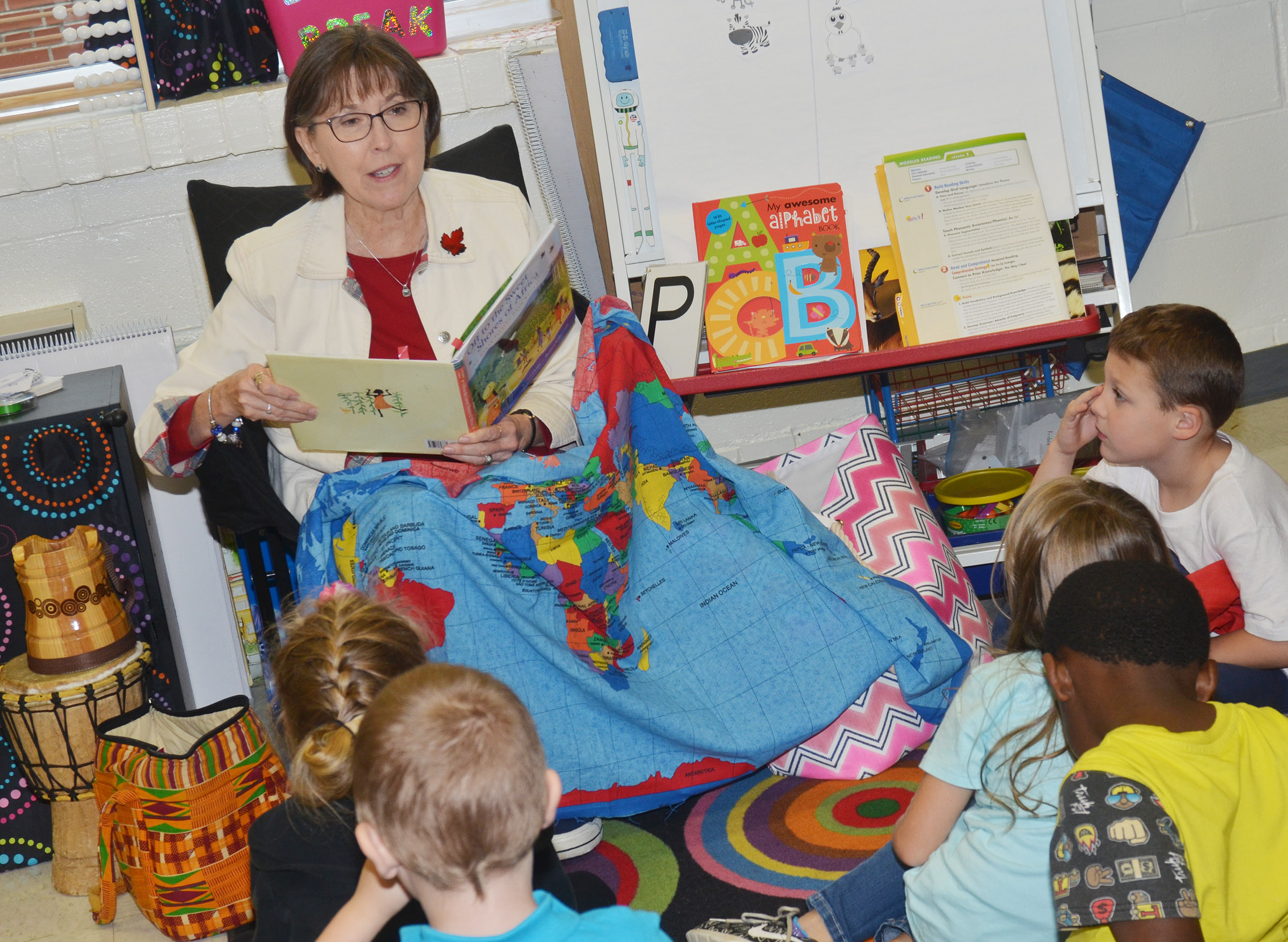 Penny Akers reads to CES kindergarteners.