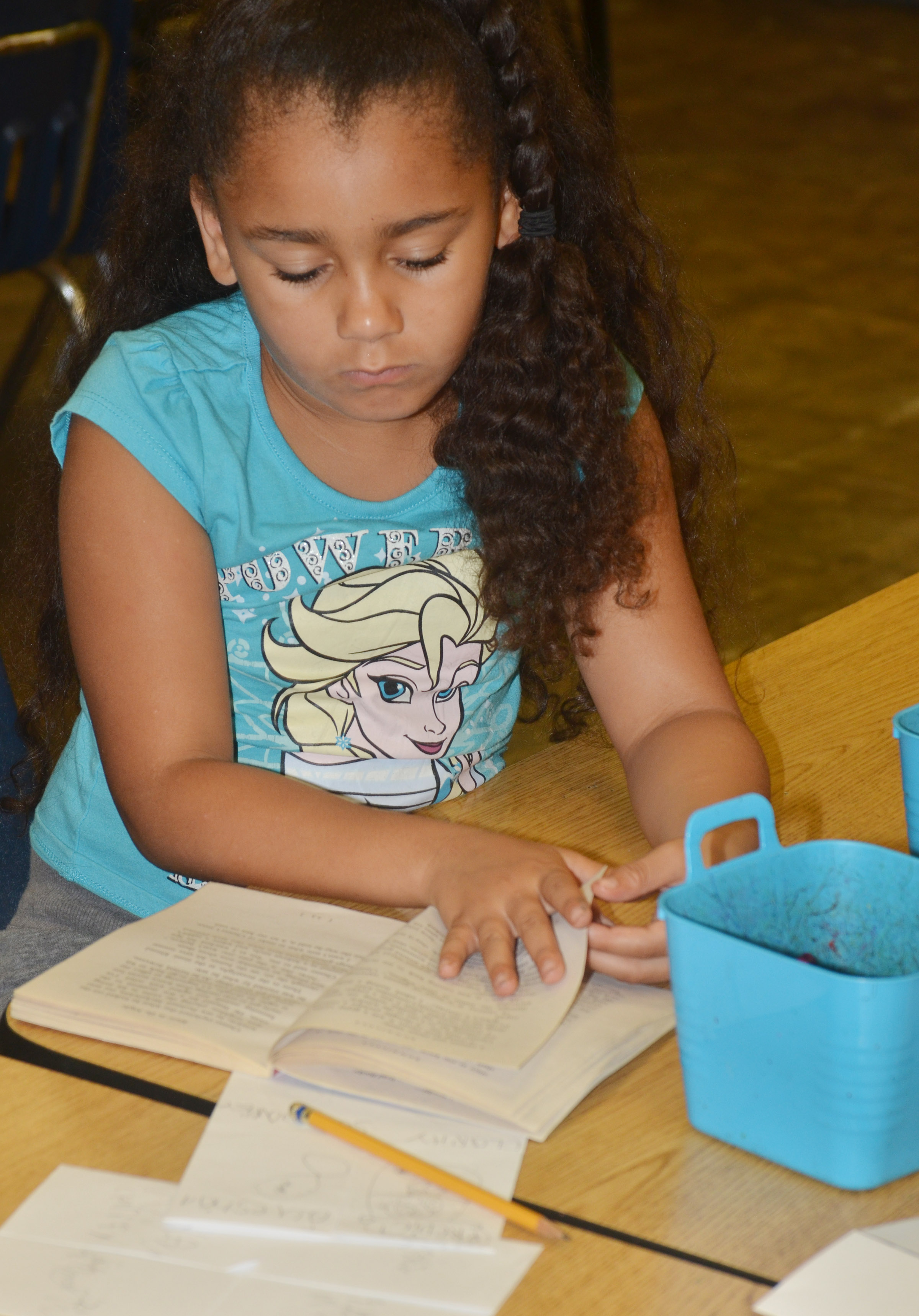 CES second-grader Keitona Whitehead turns a page.