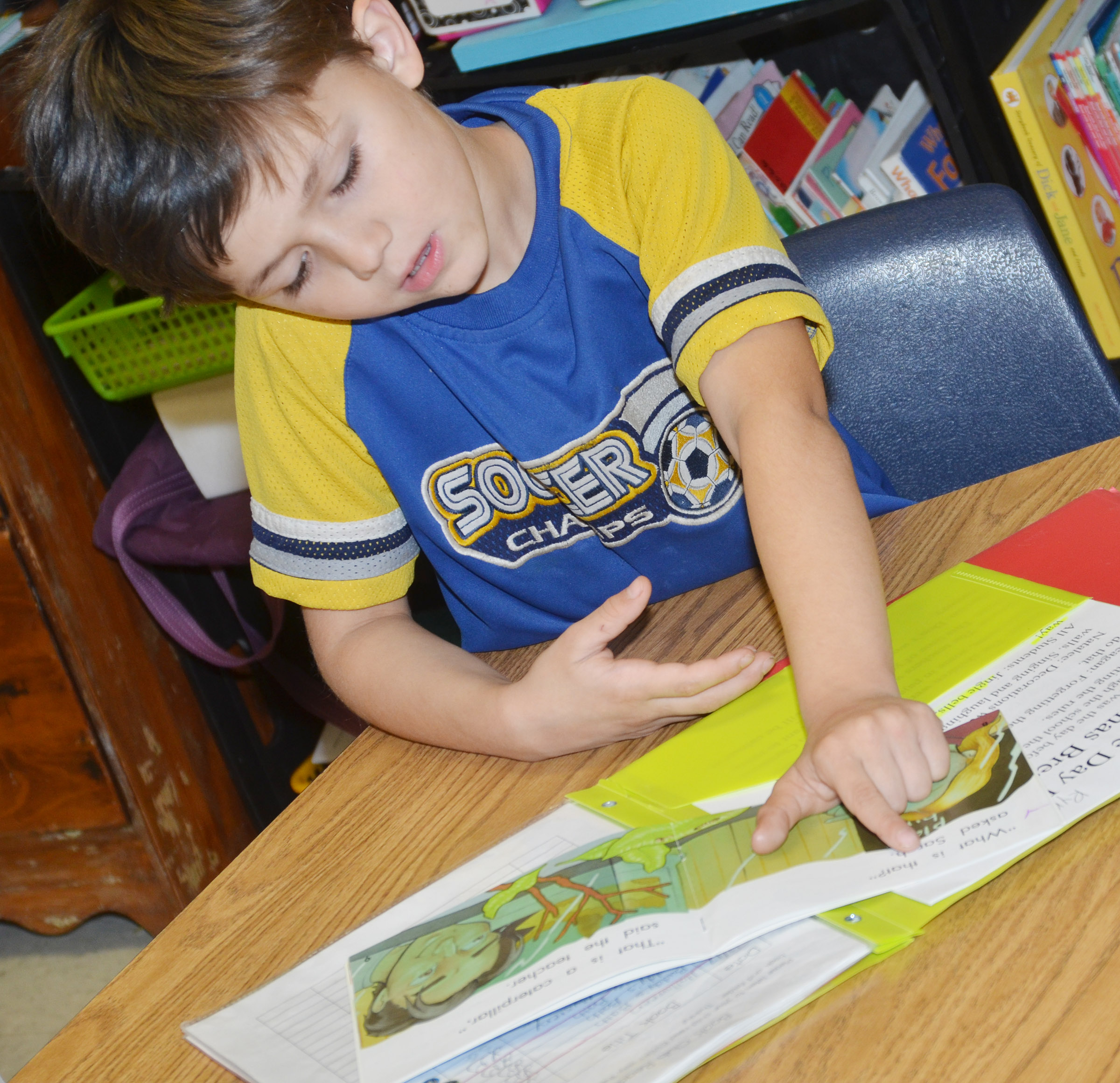 CES first-grader Levi Choate reads.