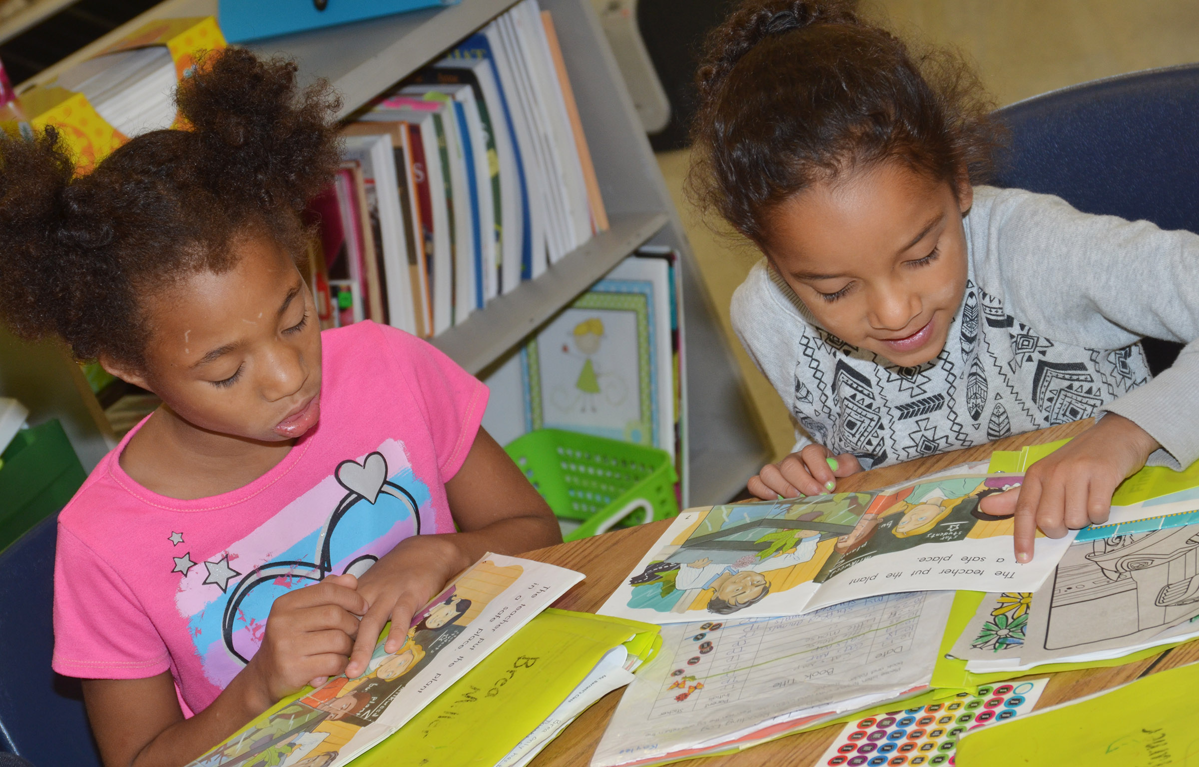 CES first-graders Brea Miller, at left, and Kaylee Thompson read together.