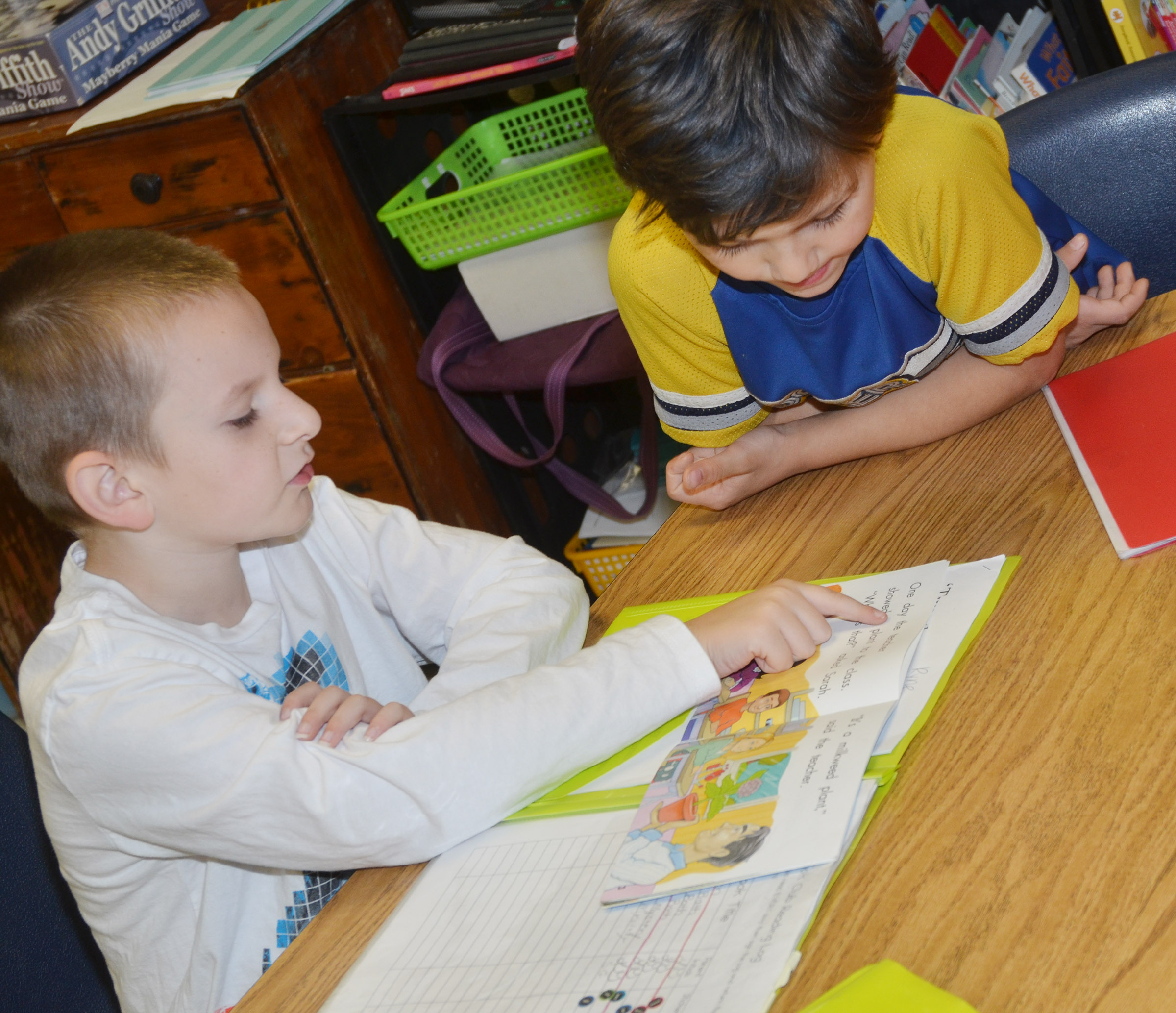 CES first-graders Ryne Gumm, at left, and Levi Choate read together.