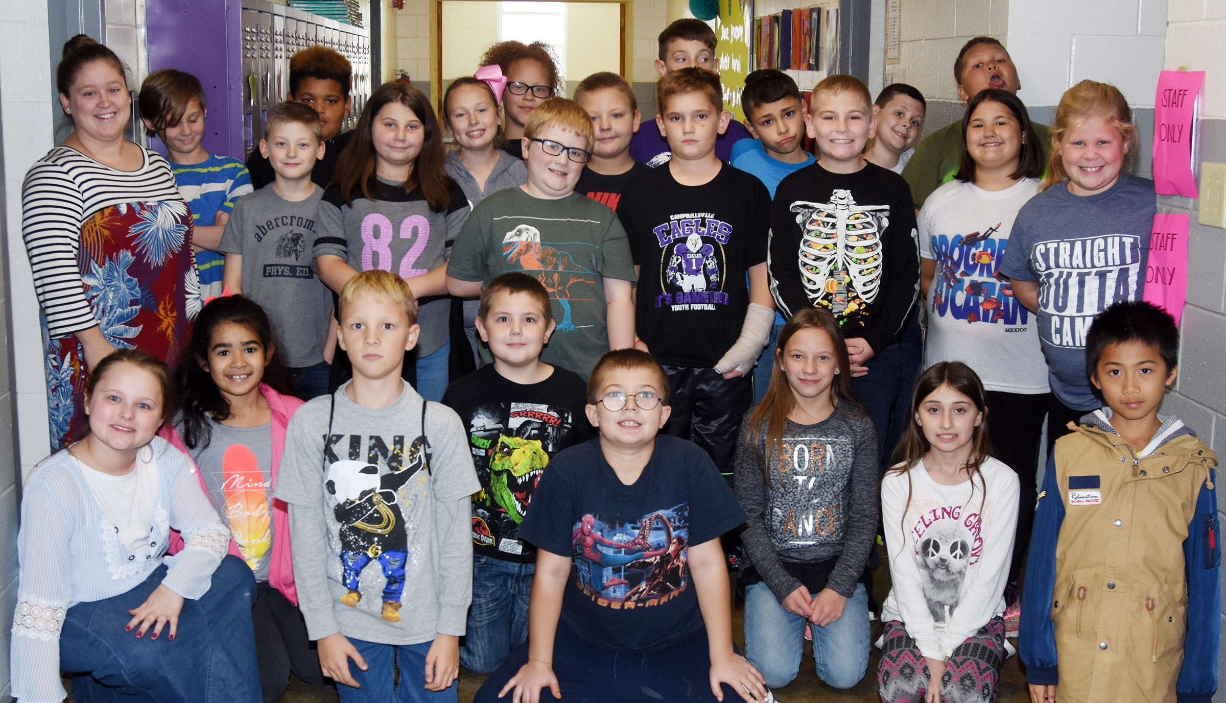 CES fourth-grade students in Maranda Wright's class collected more than 200 cans of food in the Red Ribbon Week food drive. They are pictured with substitute teacher Jordyn Bray.