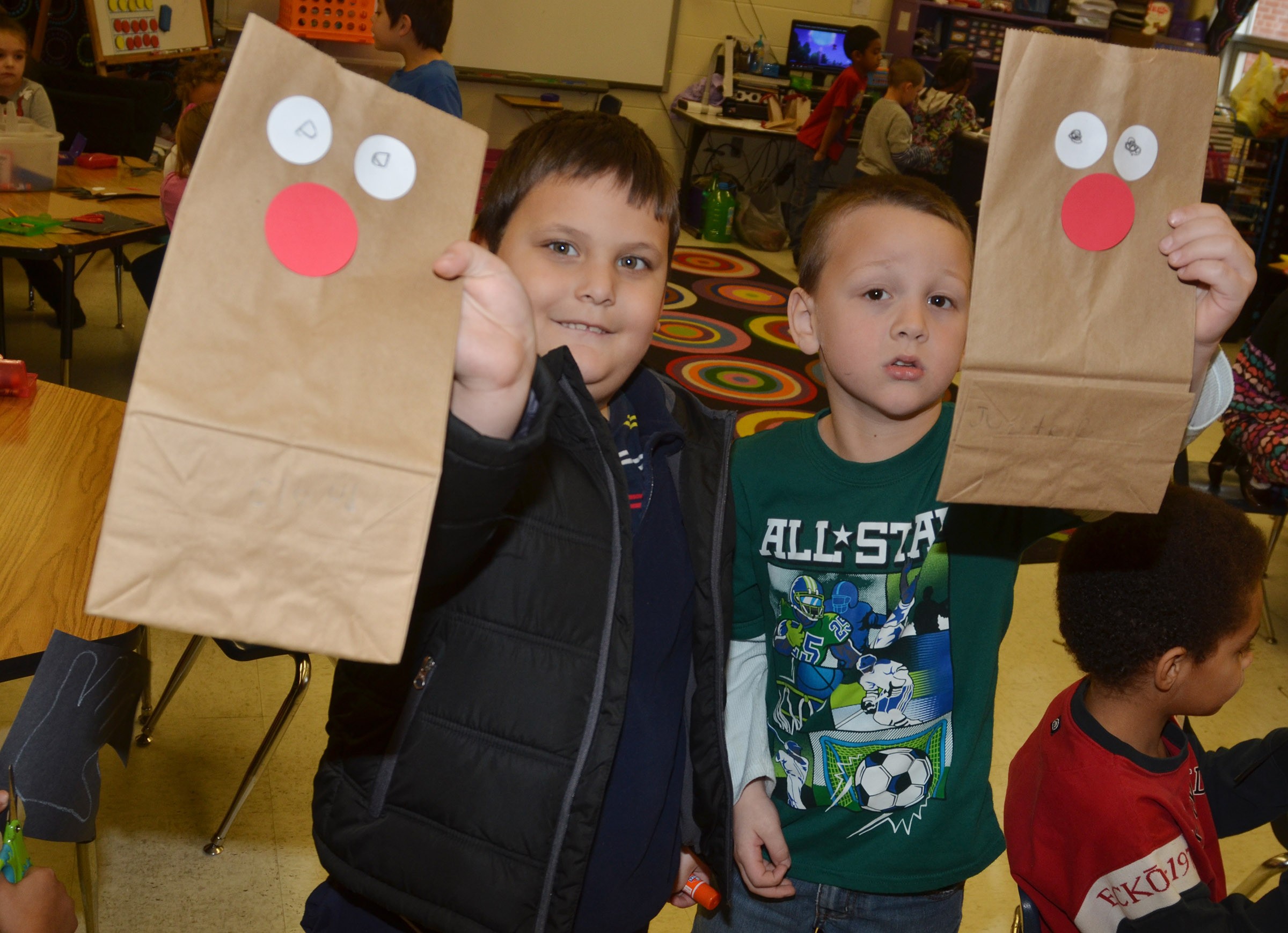 CES kindergarteners Cloud Malone, at left, and Justice Nelson hold their reindeer bags.