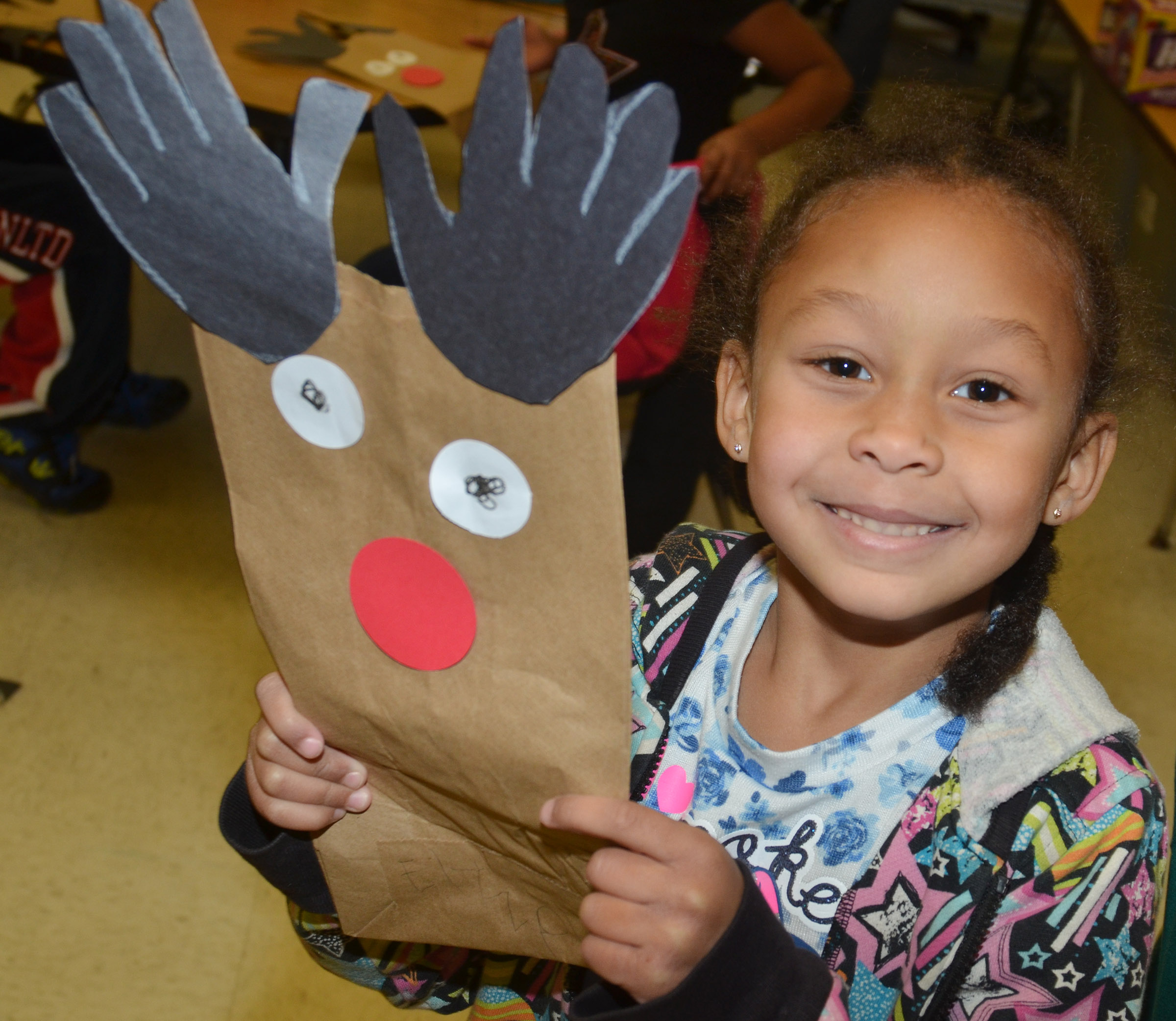 CES kindergartener Elyzabeth Fisher holds her reindeer bag.