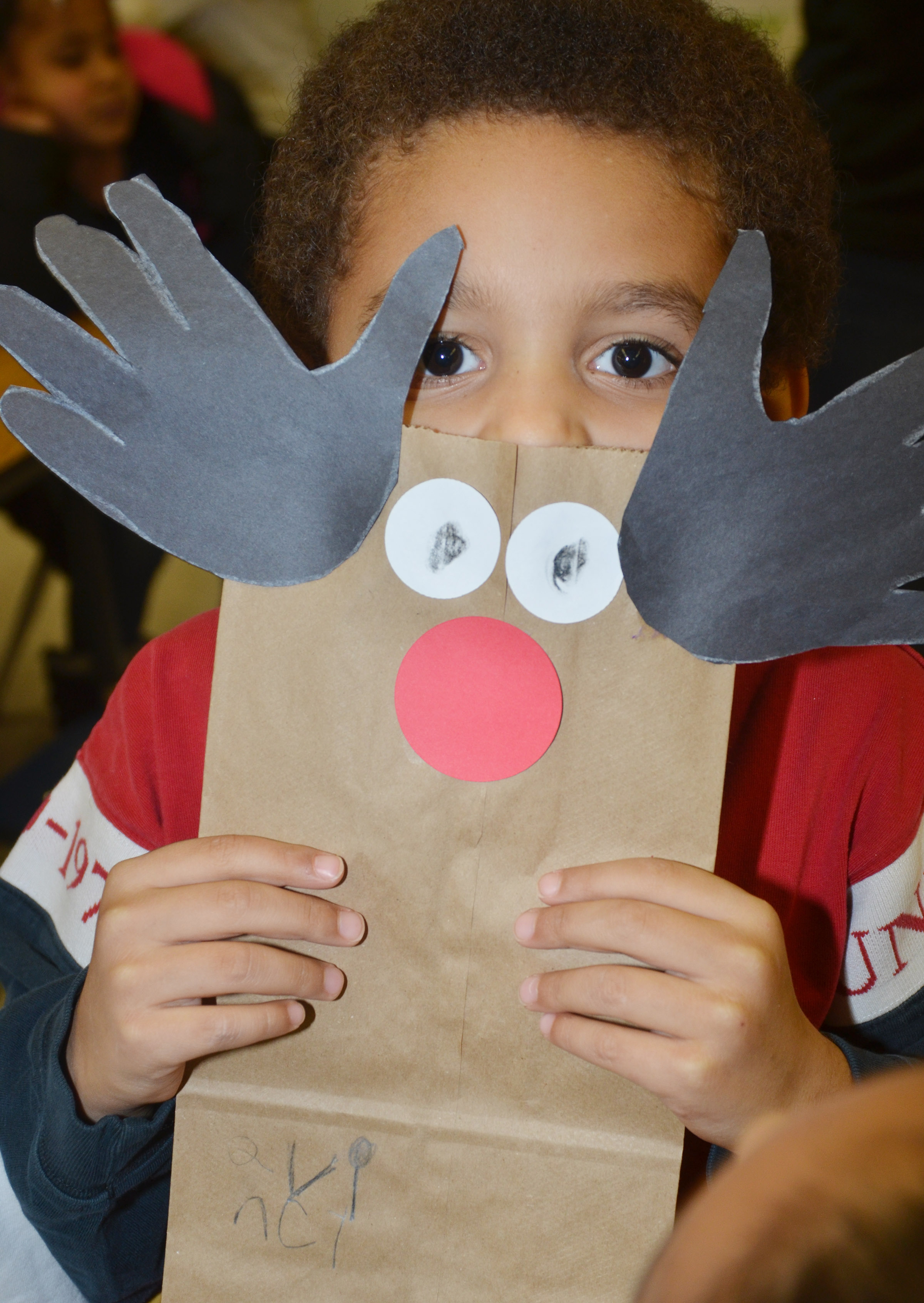 CES kindergartener Quincy Travis holds his reindeer bag.