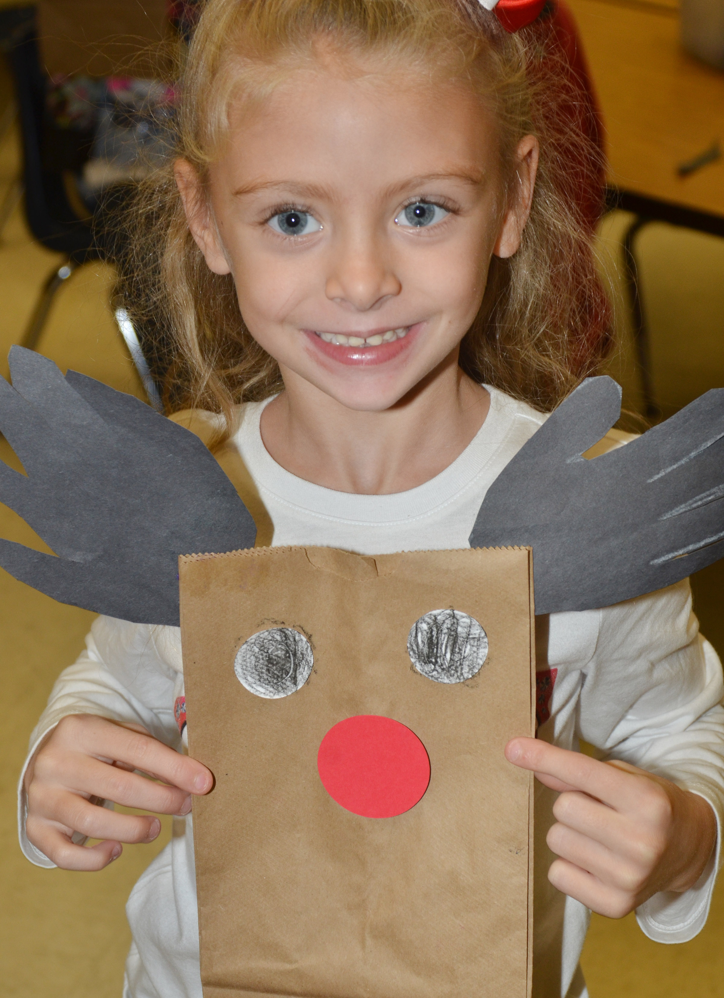 CES kindergartener Aliyah Litsey holds her finished reindeer bag.