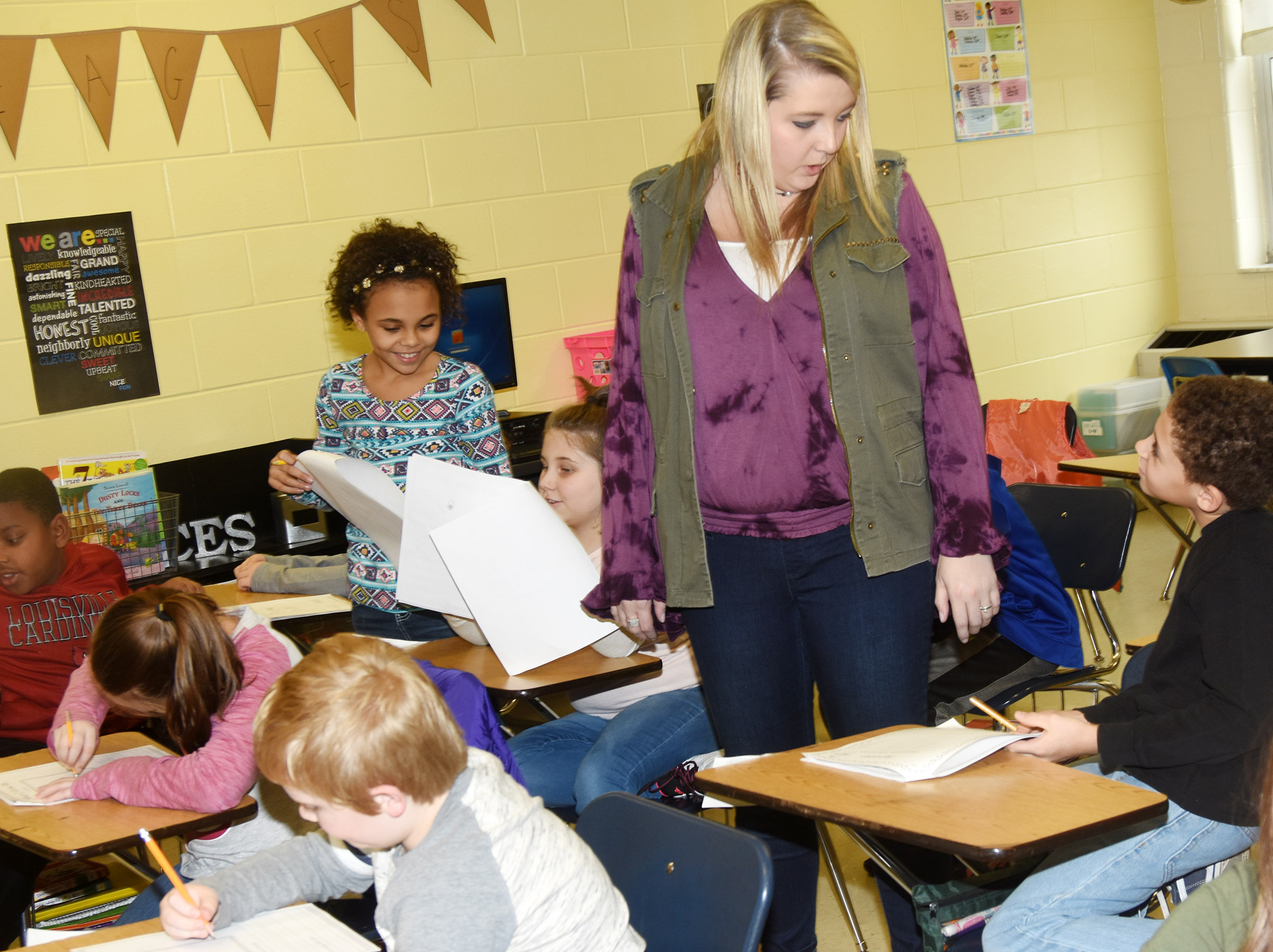 CES third-grade teacher Keri Richard talks to her students about their future careers.