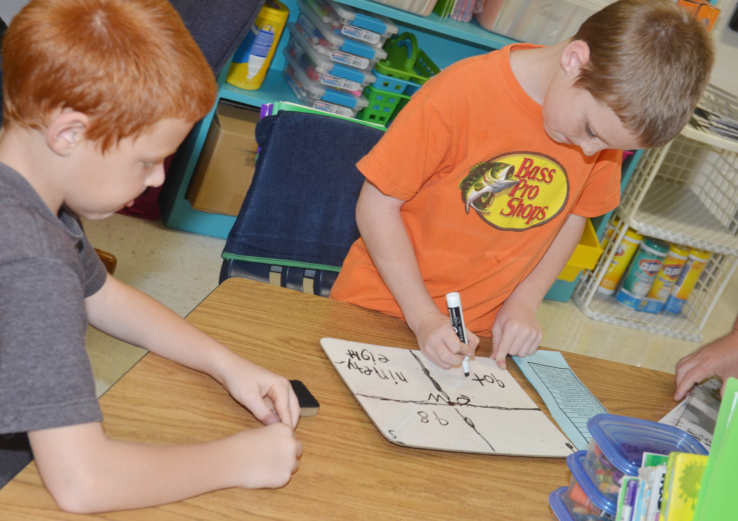 CES second-graders Carter Wethington, at left, and James Brunner practice writing numbers in expanded form.