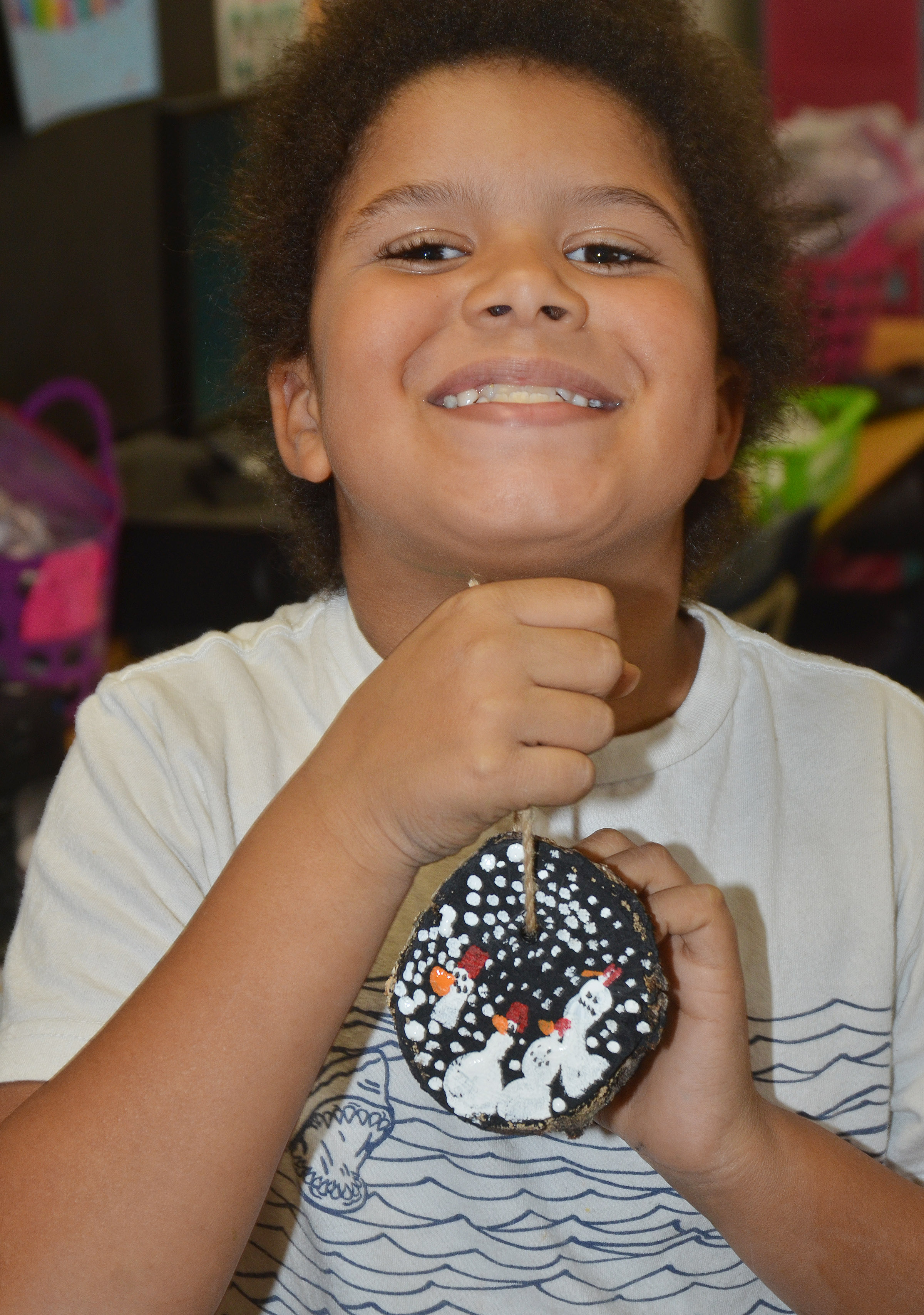CES second-grader Navon Copeland holds his finished ornament.