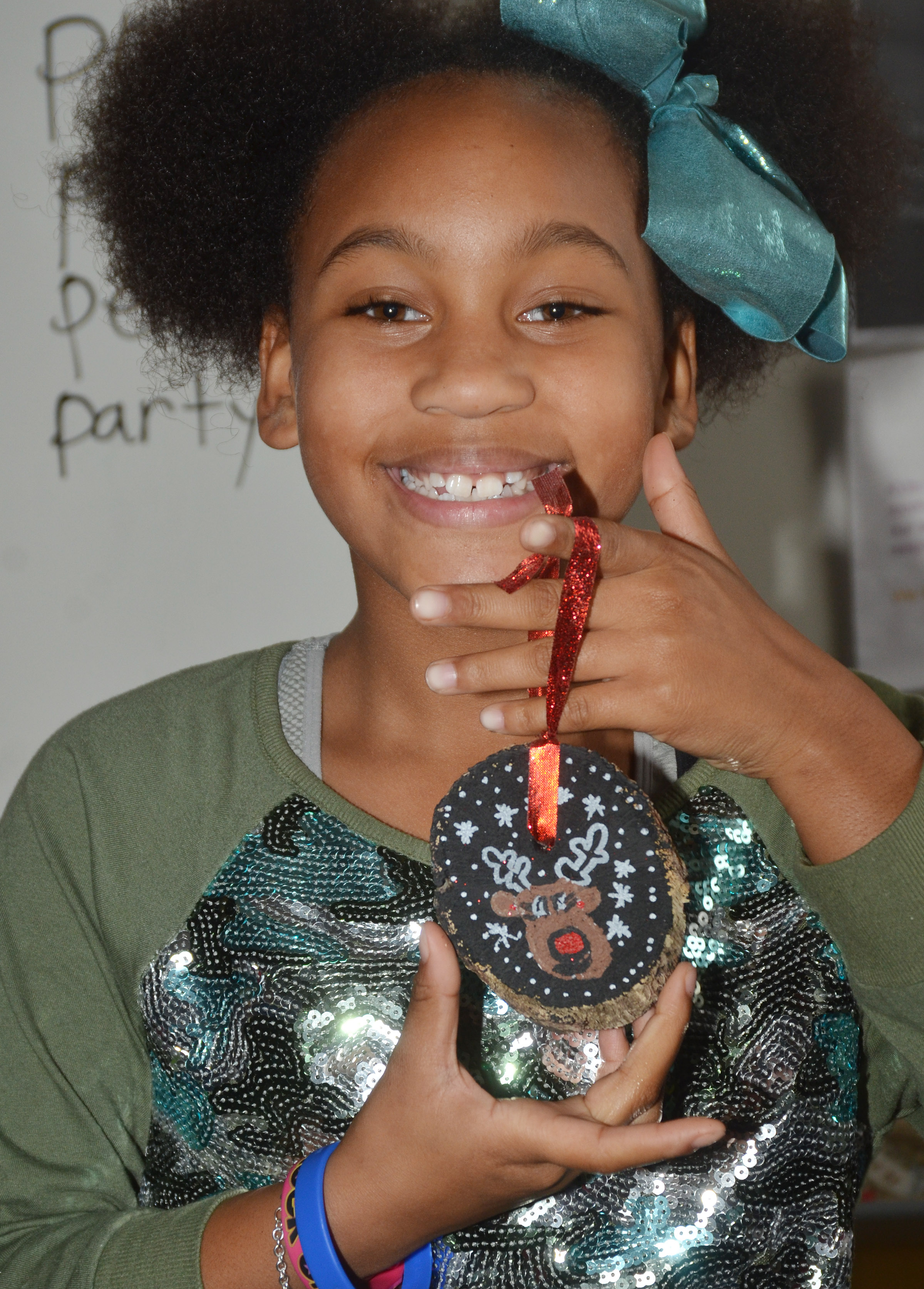 CES second-grader Aliy Dunn holds her finished ornament.