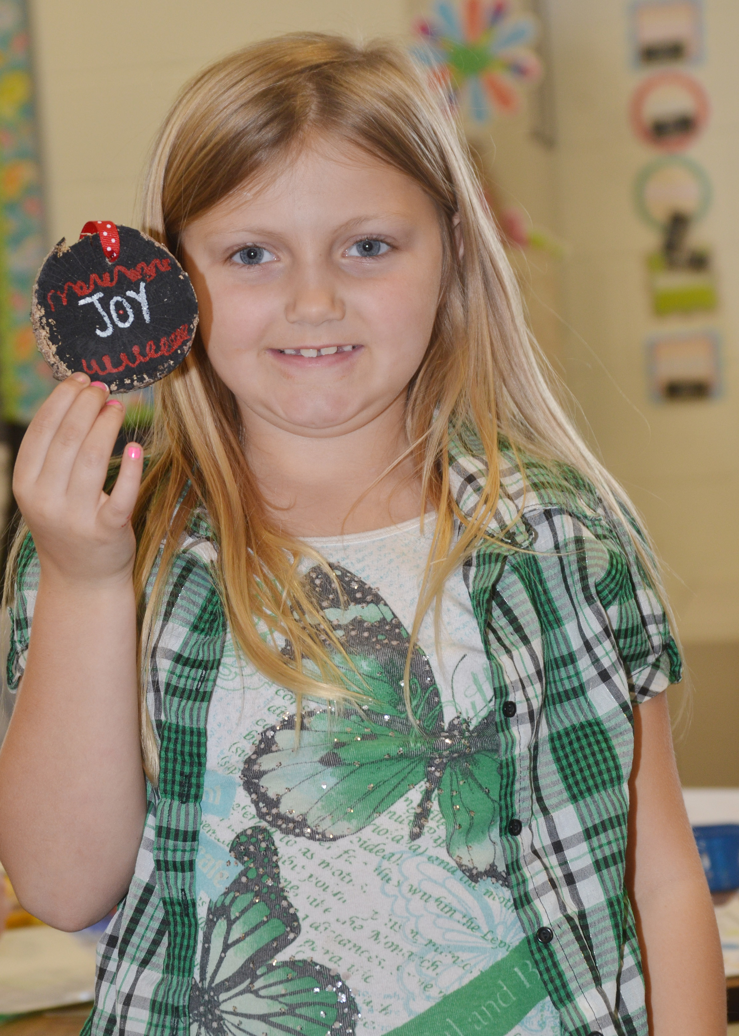 CES second-grader Asia Singleton holds her finished ornament.
